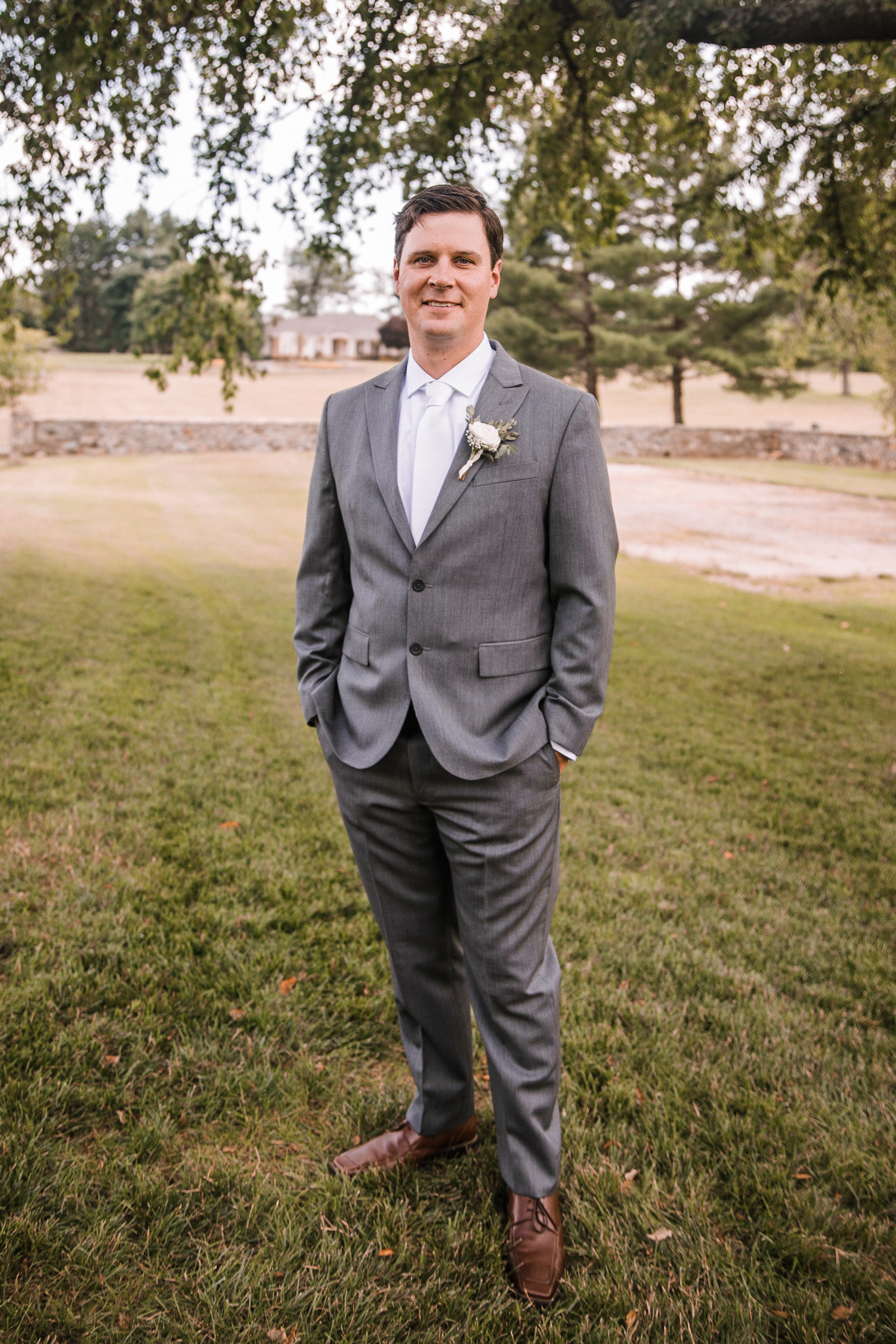 portrait of groom at Evergreen Country Club