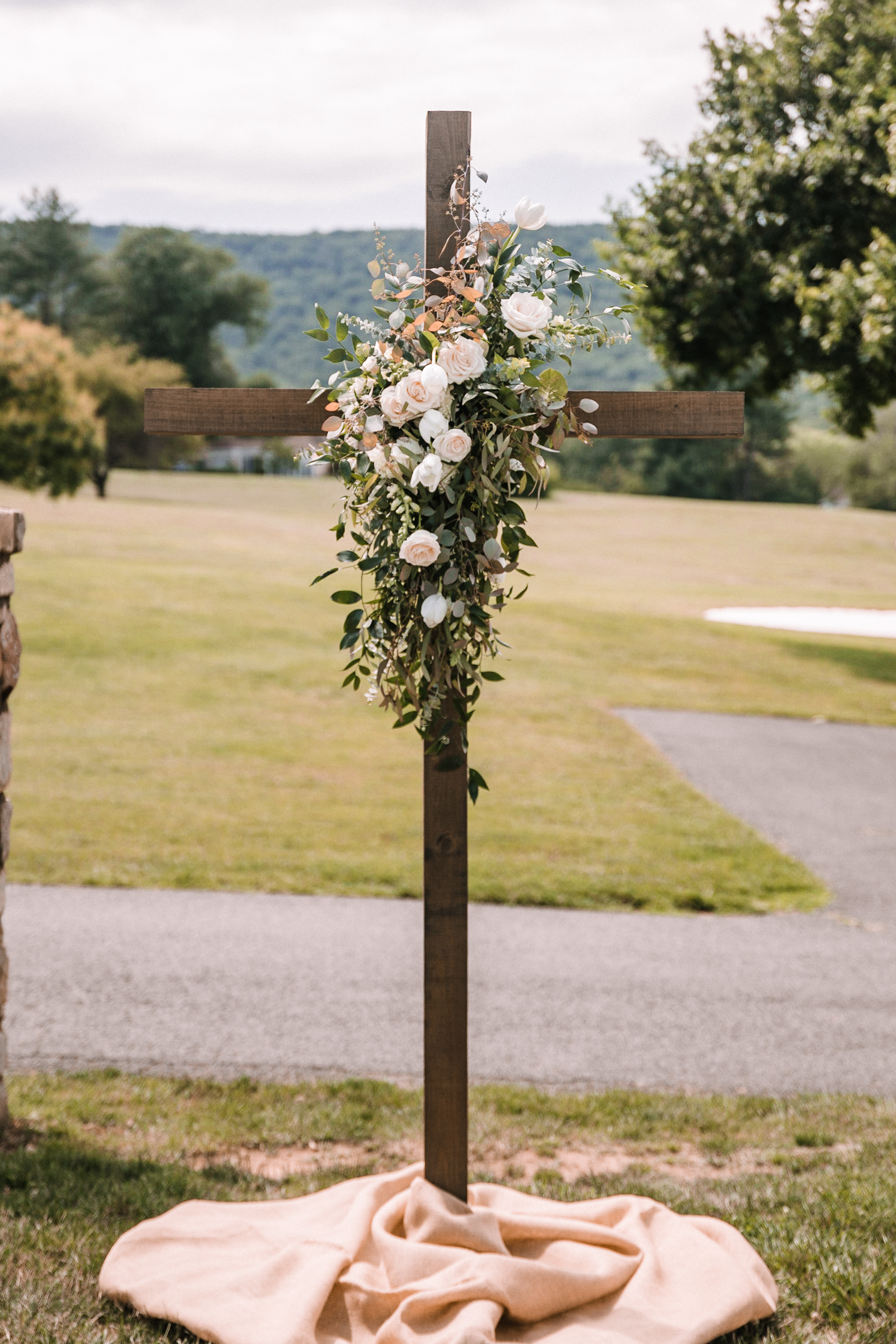 ceremony detail shot of cross at Evergreen Country Club
