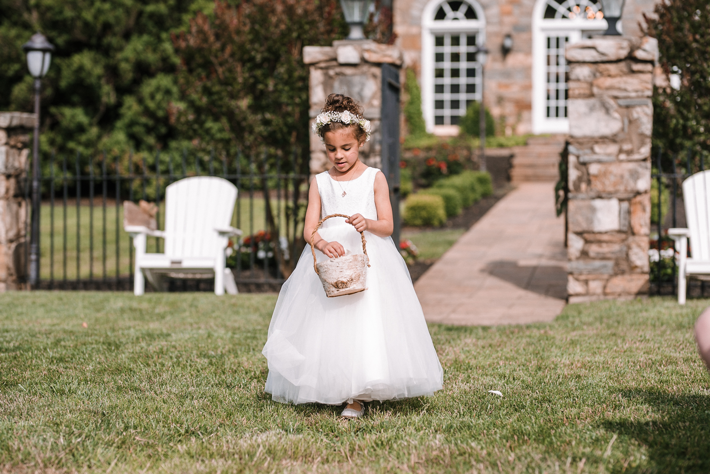 flower girl coming down the aisle at Evergreen Country Club