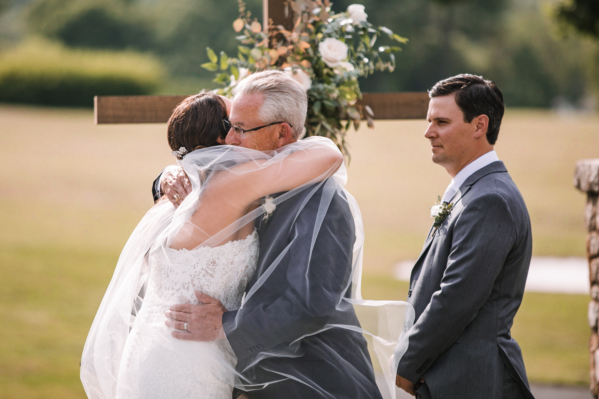 father of the bride giving away bride at Evergreen Country Club