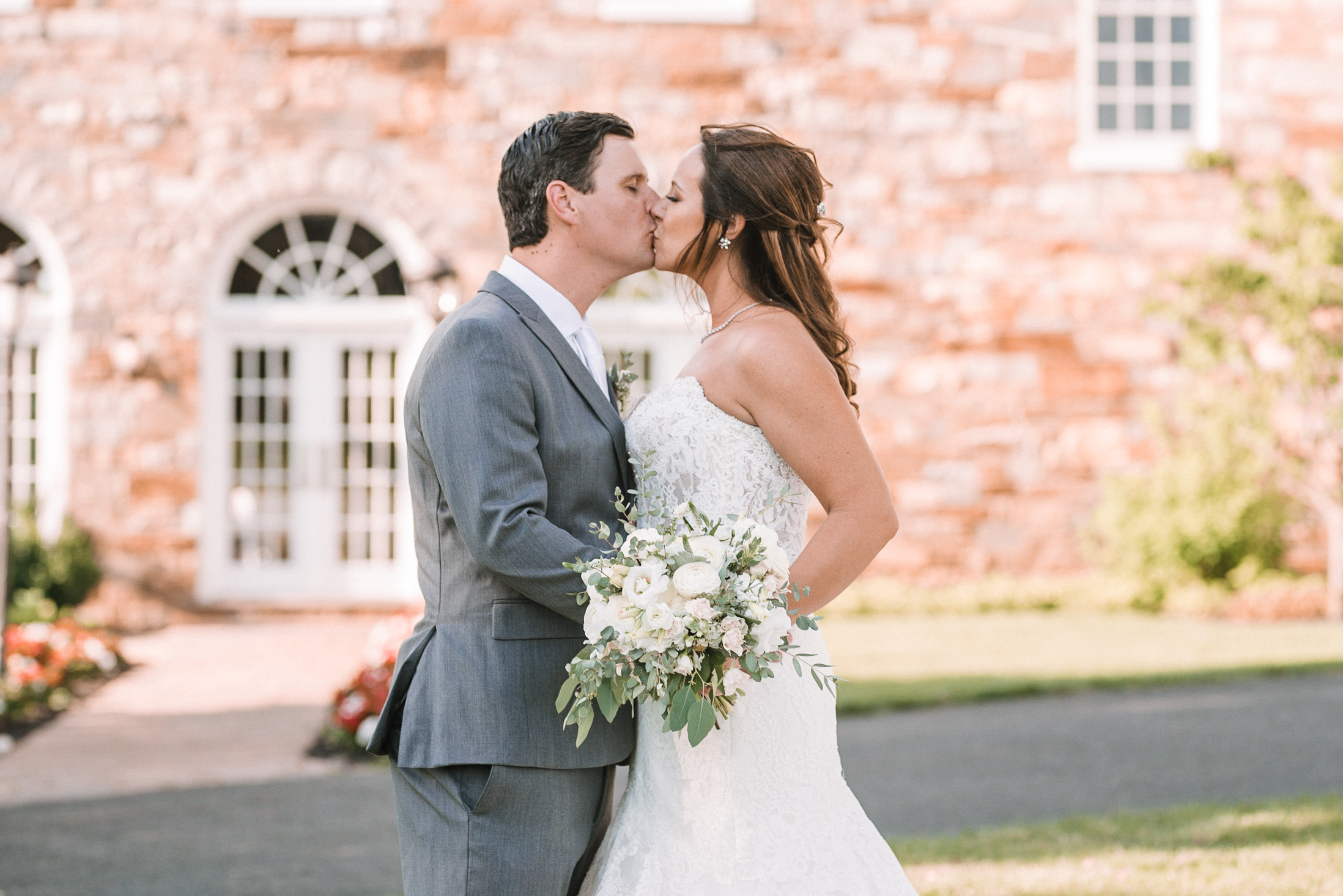 bride and groom kissing at Evergreen Country Club