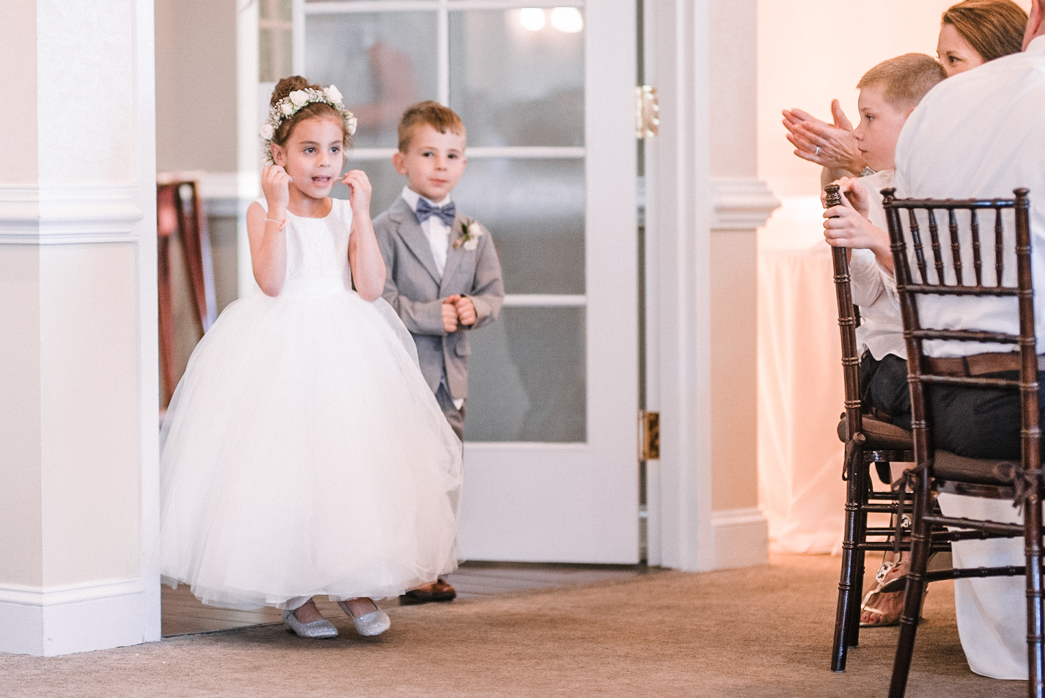 flower girl entering reception at Evergreen Country Club