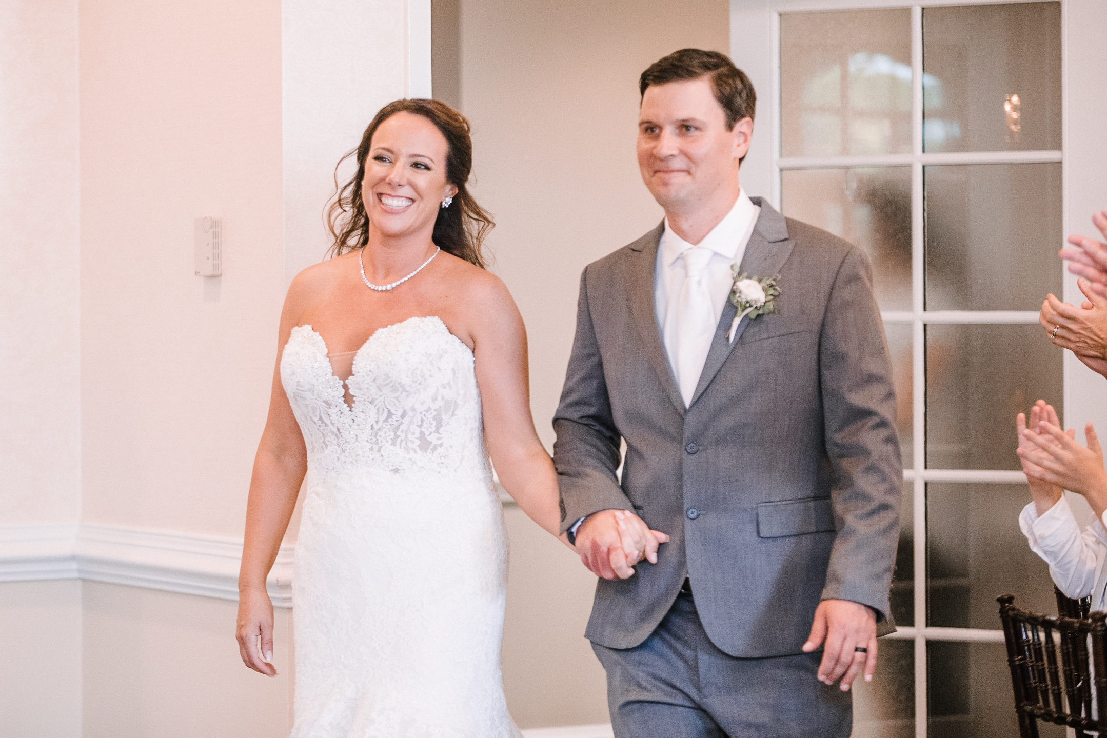 bride and groom entering reception at Evergreen Country Club