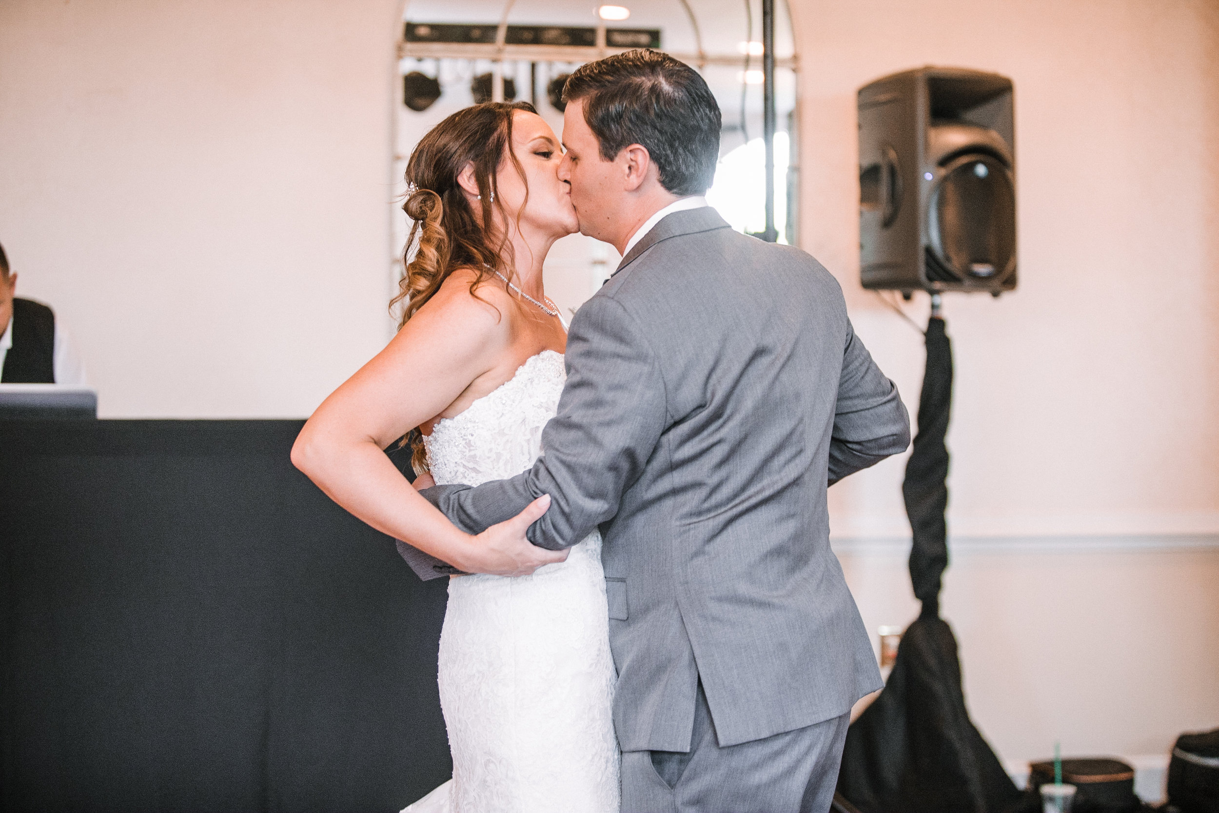 bride and groom kissing at reception at Evergreen Country Club