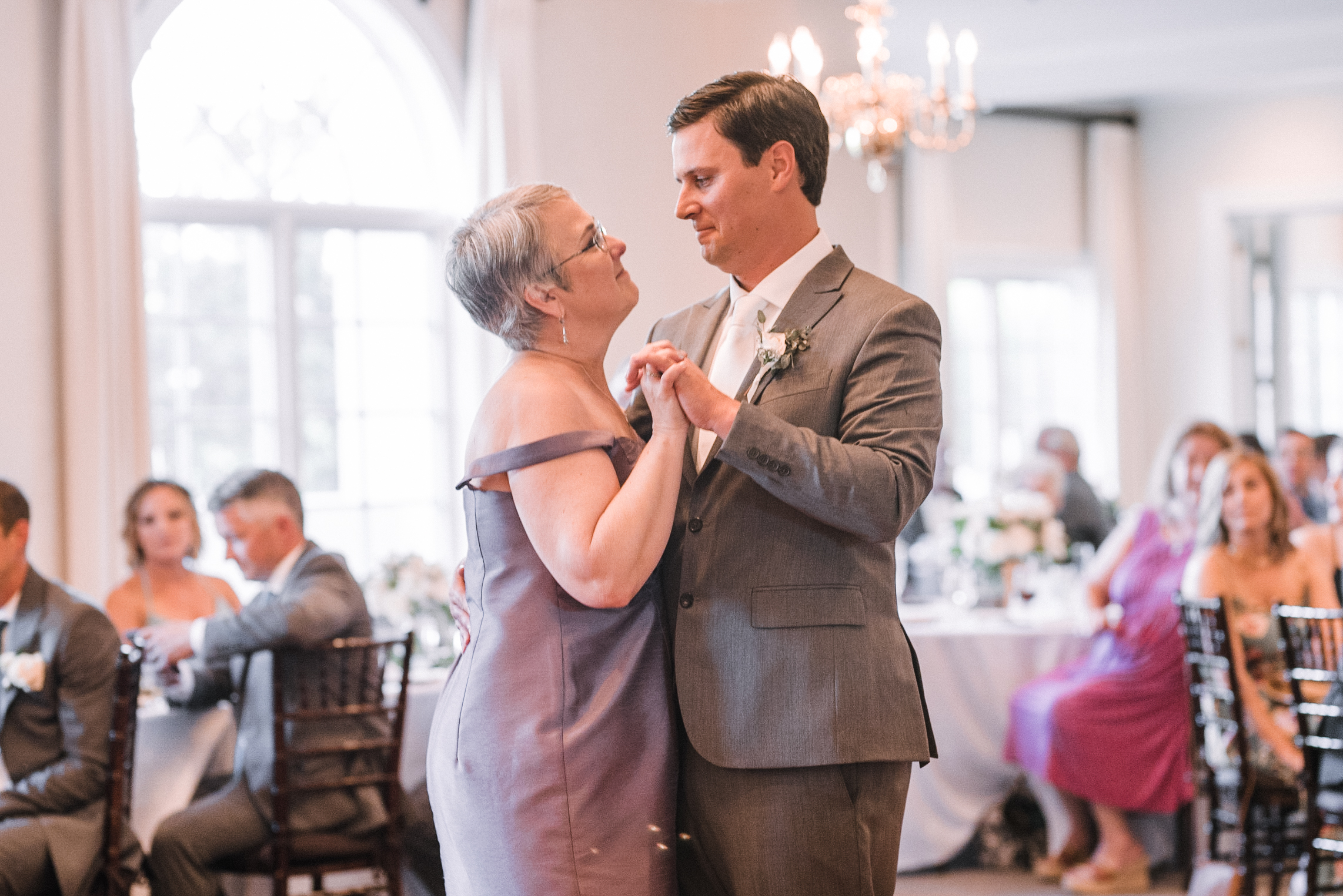 groom and his mom dancing at Evergreen Country Club