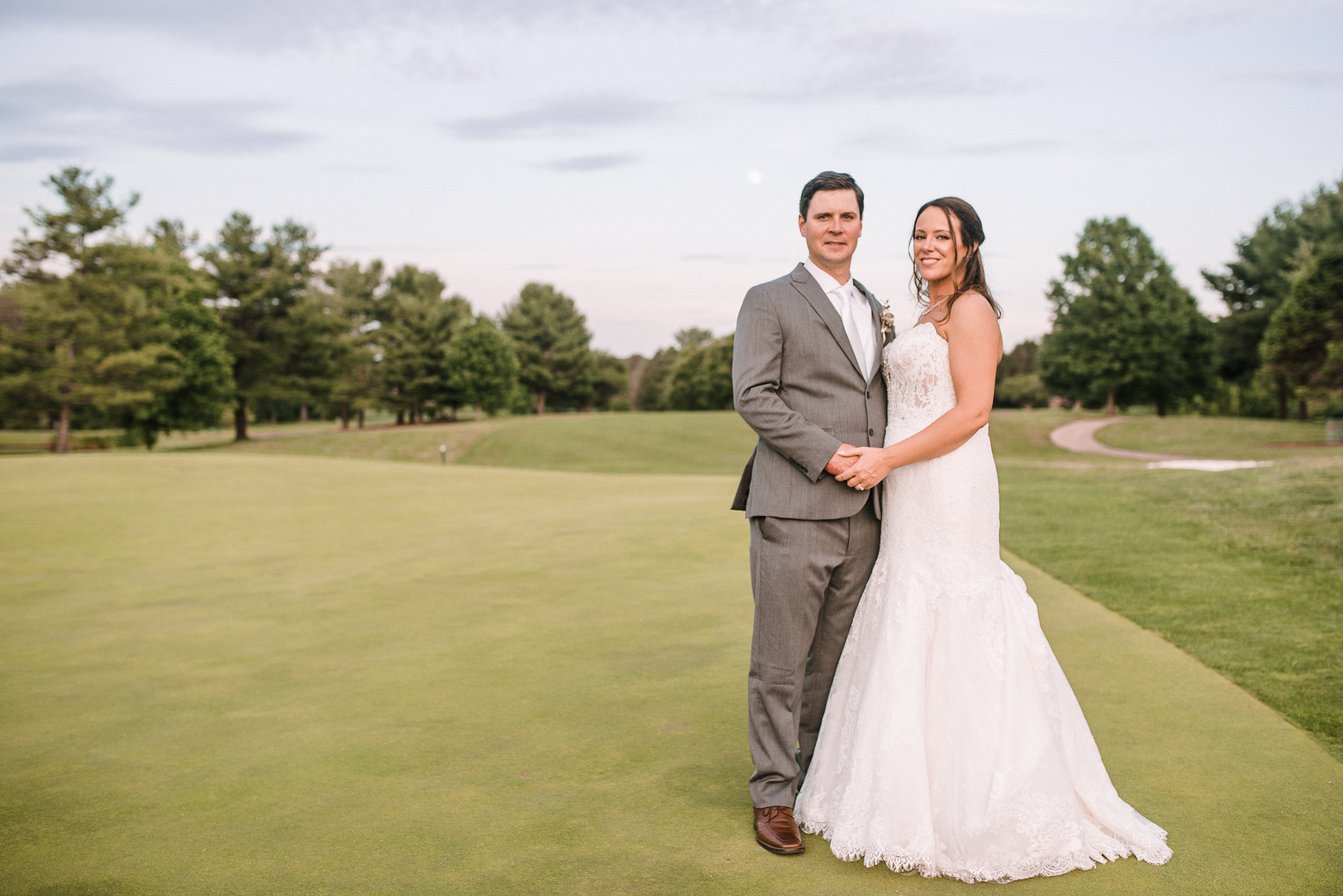 bride and groom embracing at Evergreen Country Club