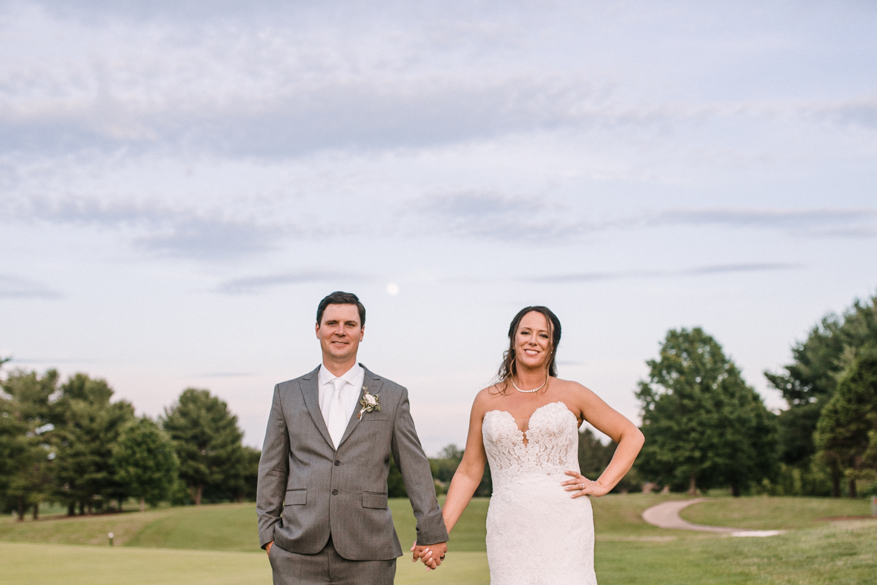 bride and groom holding hands at Evergreen Country Club