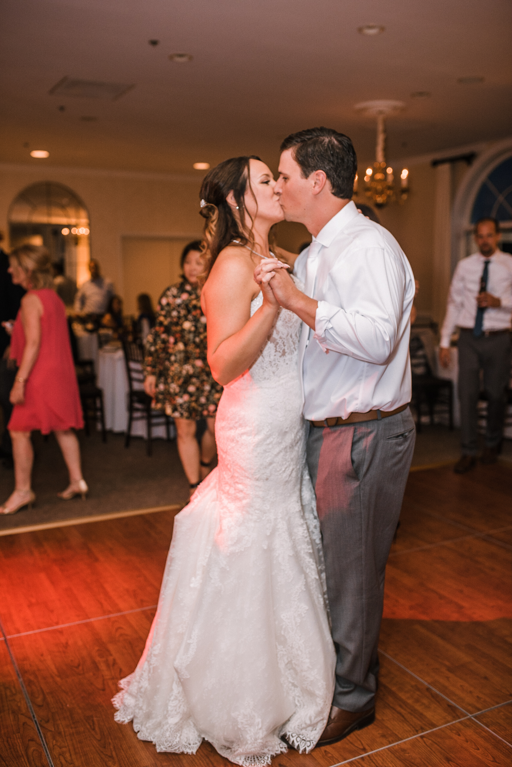 bride and groom kissing as they dance at Evergreen Country Club