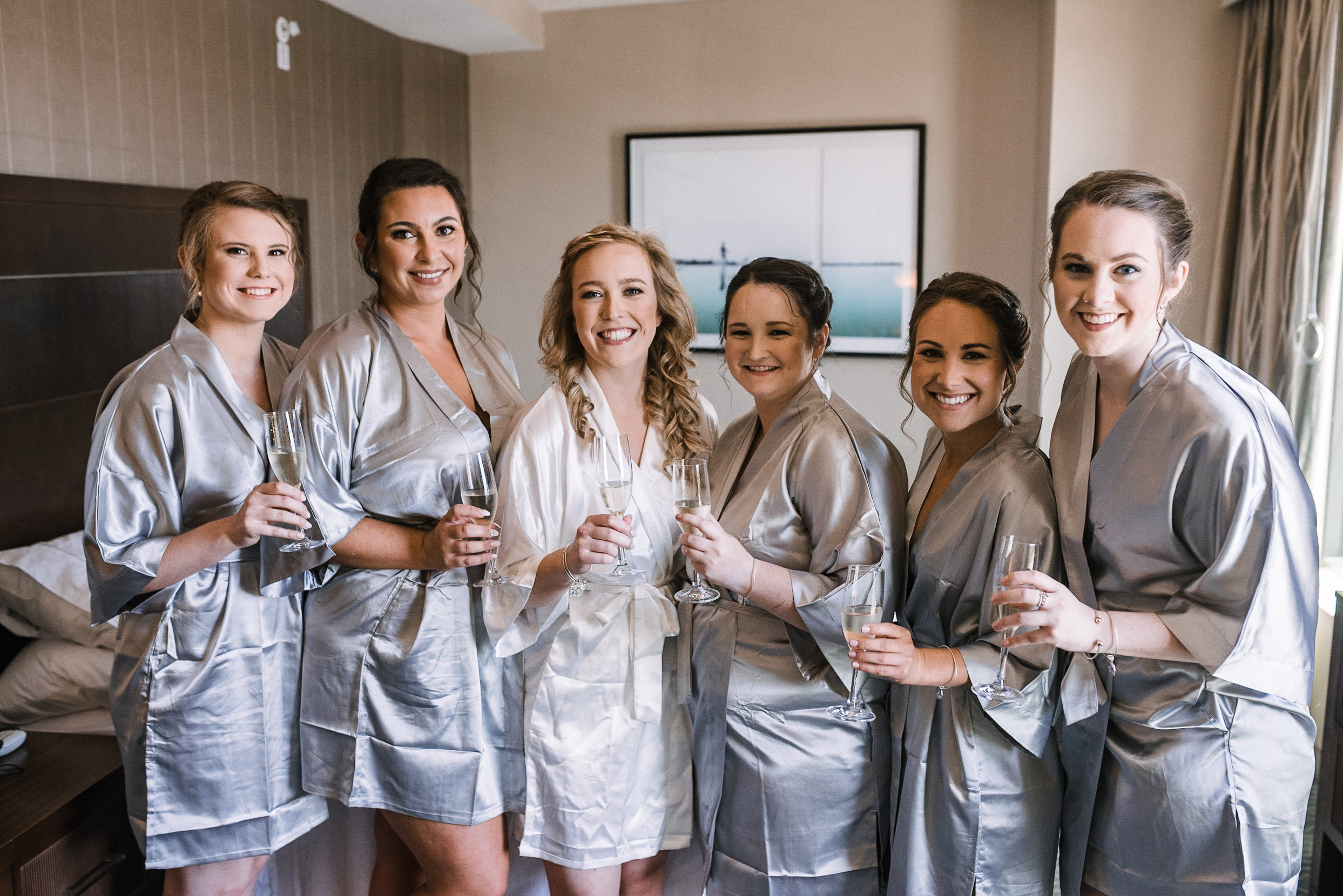 Bride and Bridesmaids drinking champagne at Embassy Suites in Springfield, VA