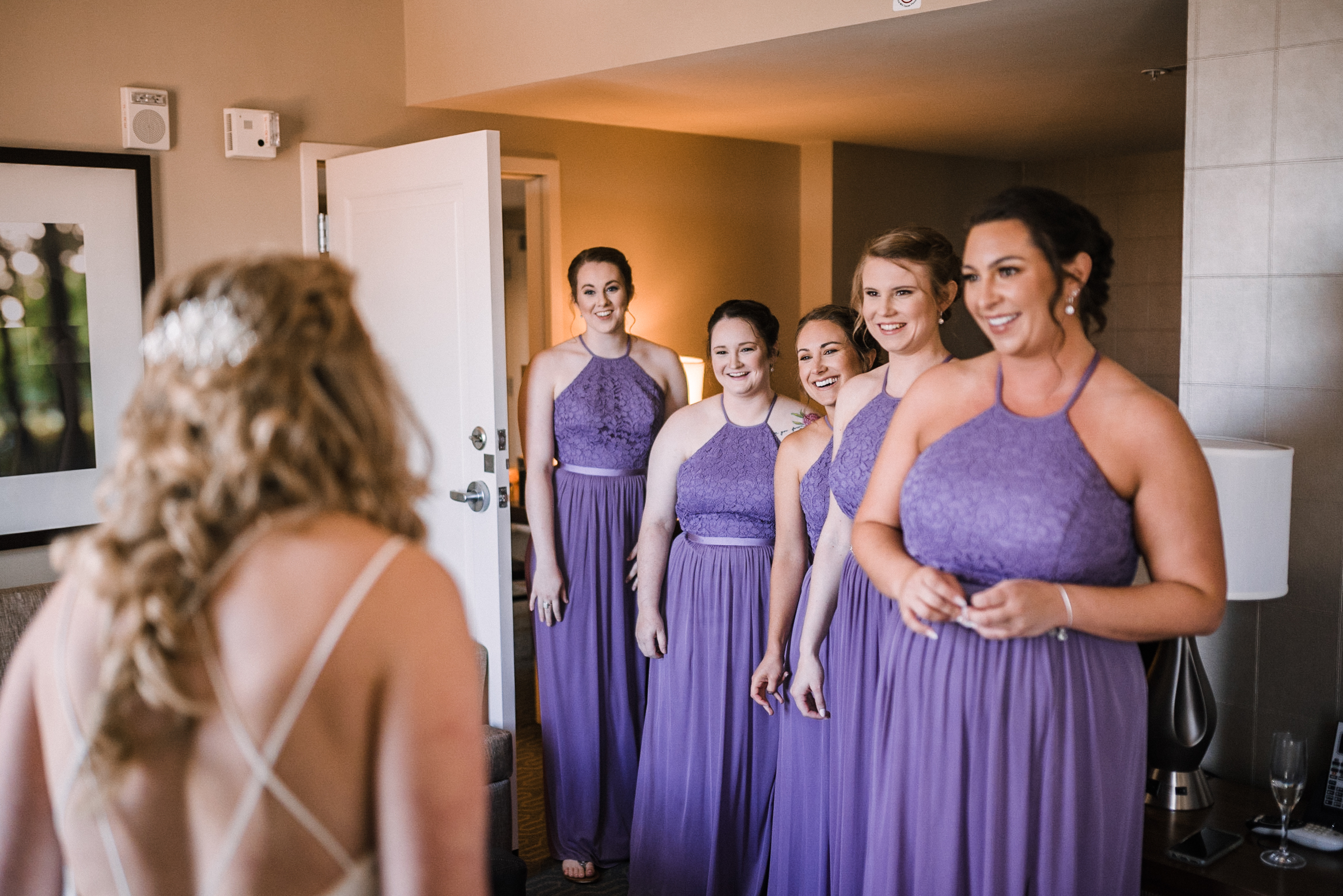 Bridesmaids seeing bride first look at Embassy Suites in Springfield, VA