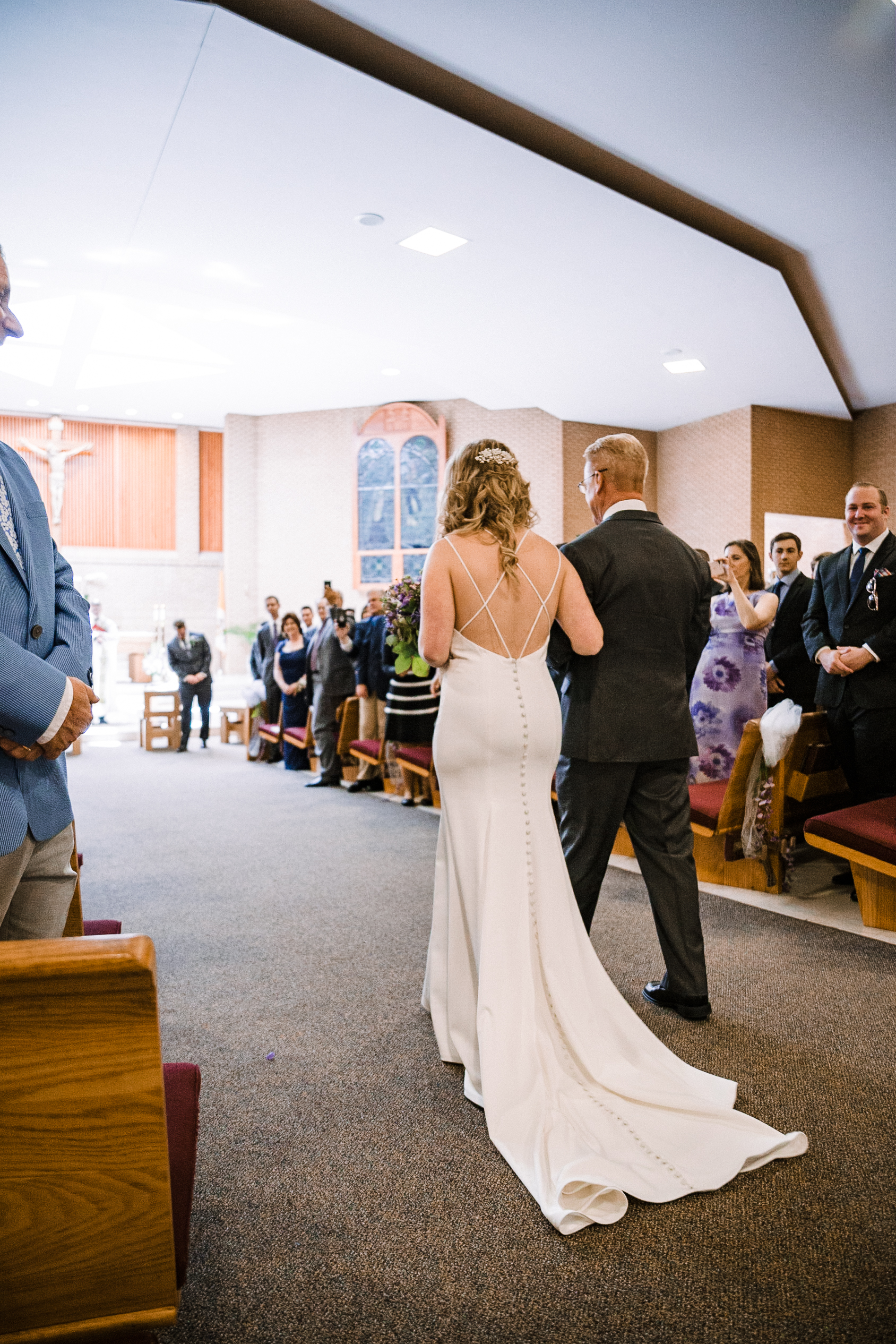 Bride walking down the aisle at St. Bernadette Catholic Church