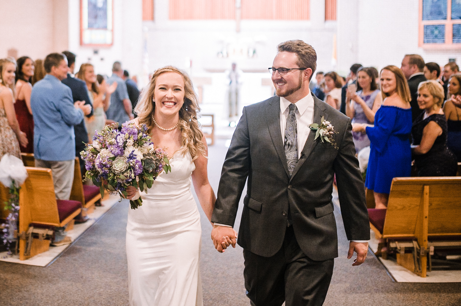 bride and groom walking up the aisle at St. Bernadette Catholic Church