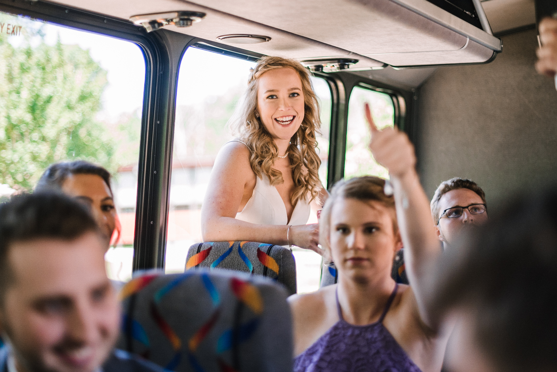 Bride smiling on bus at St. Bernadette Catholic Church