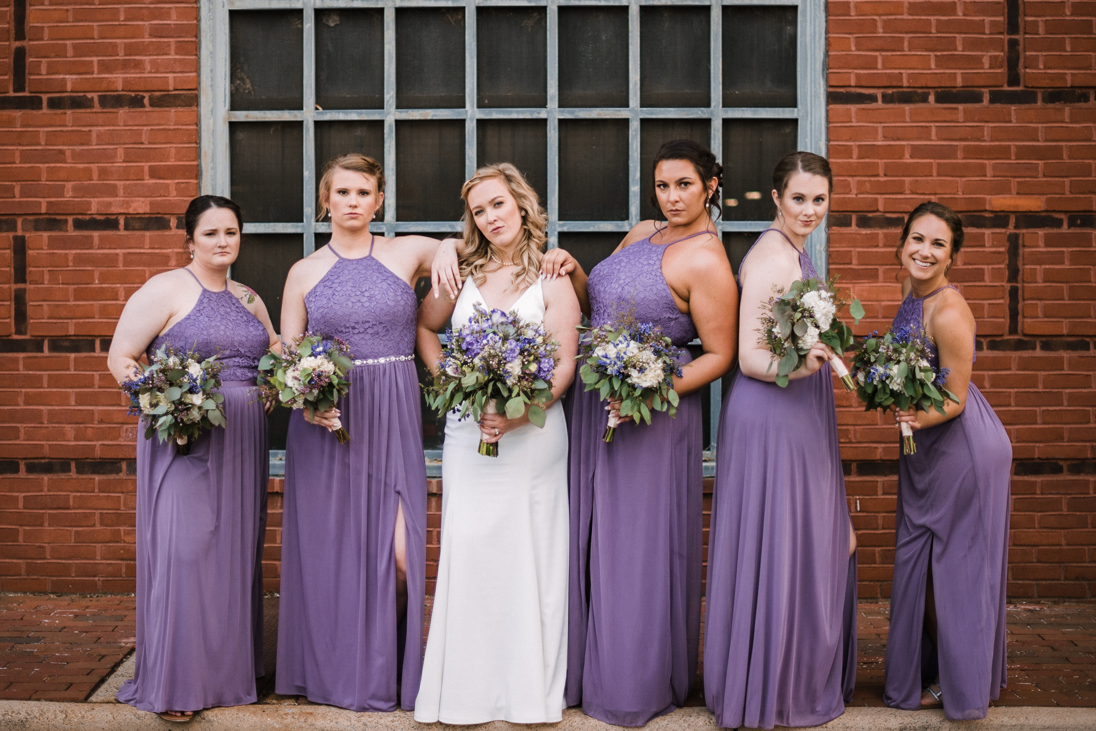 bride and bridesmaids doing a sassy pose at Old Town Alexandria