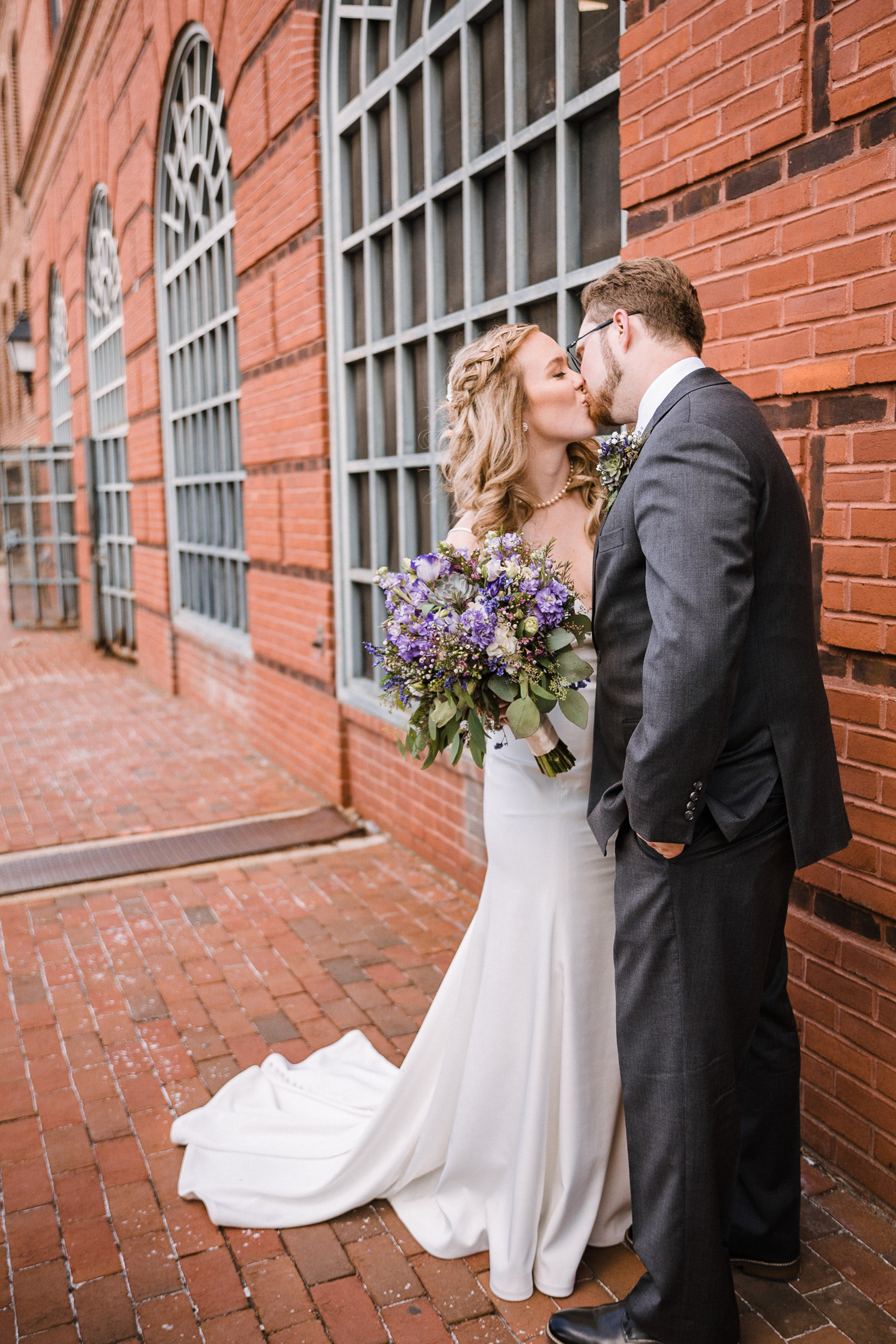 bride and groom kissing at Old Town Alexandria