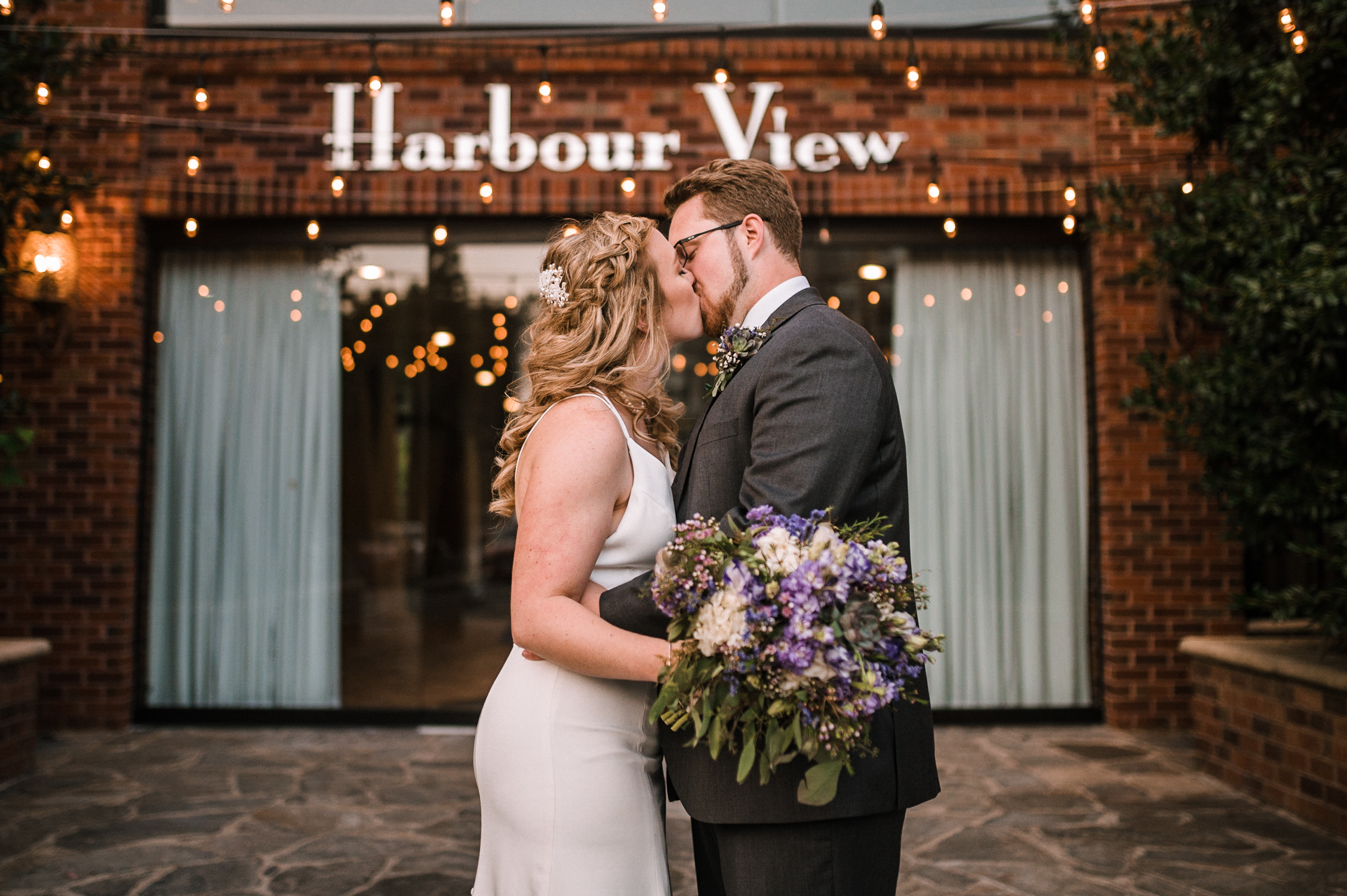 bride and groom kissing at Harbour View