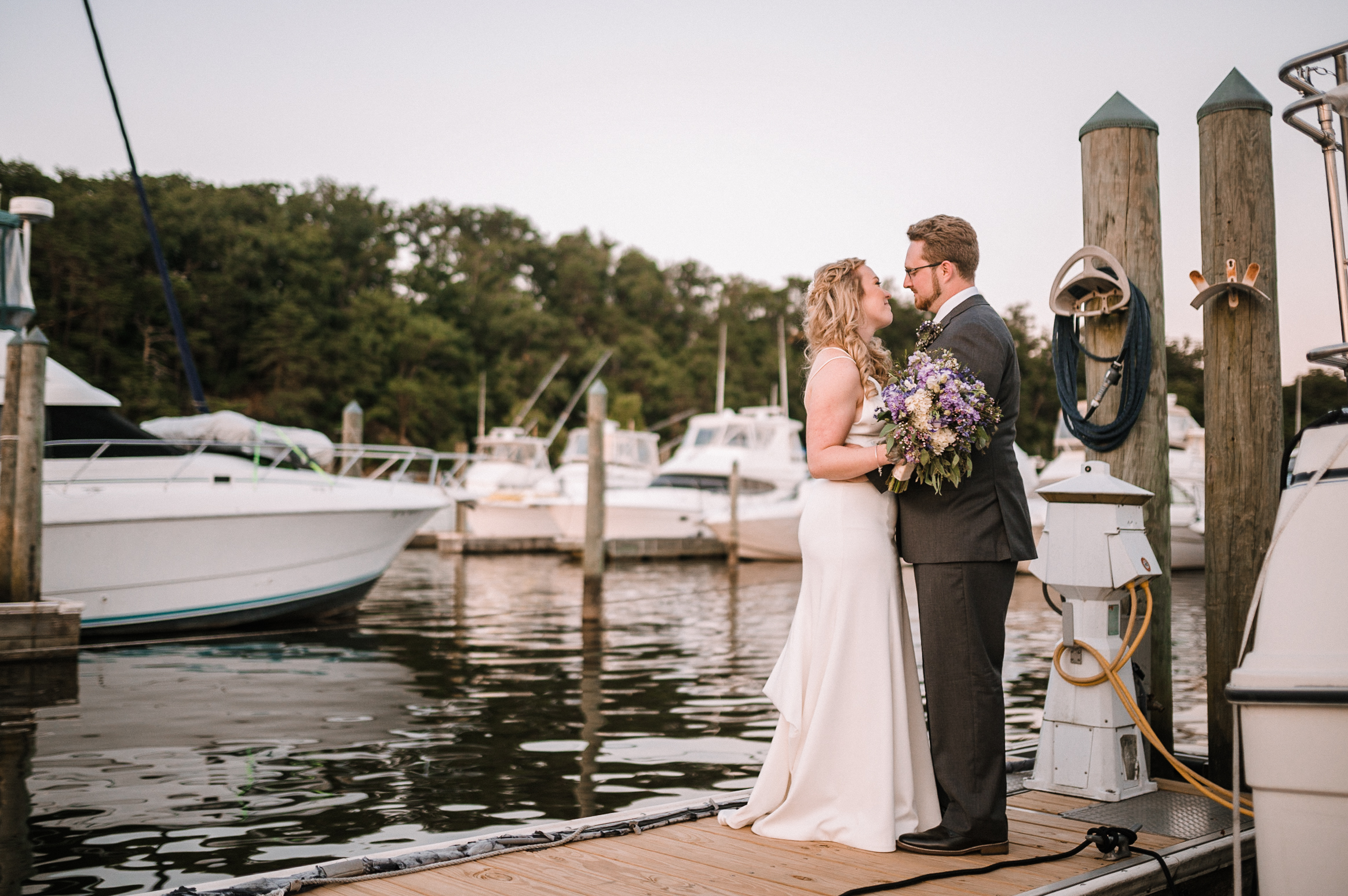 bride and groom embracing at Harbour View