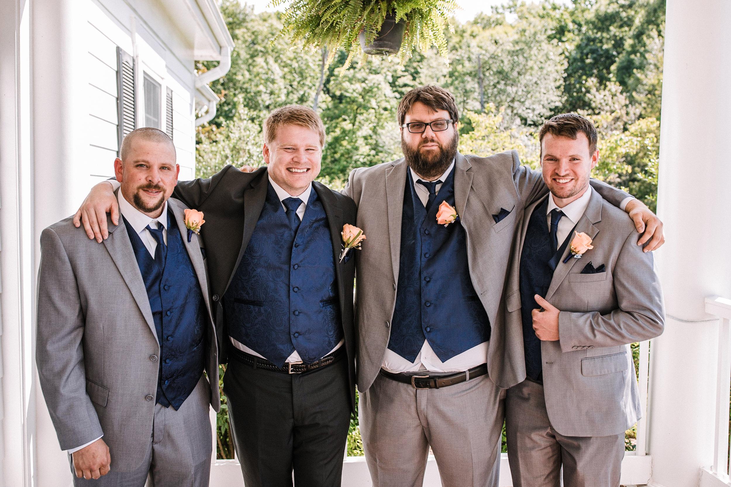 groom and groomsmen smiling at Westfields Golf Club