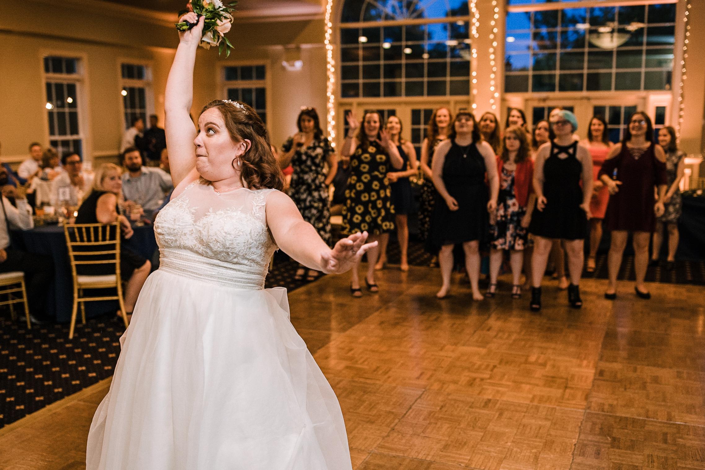 bride throwing bouquet at Westfields Golf Club