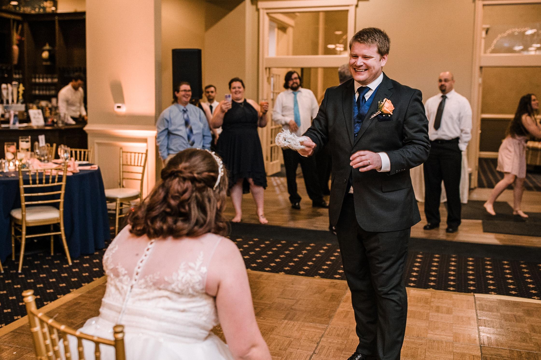 groom getting garter at Westfields Golf Club