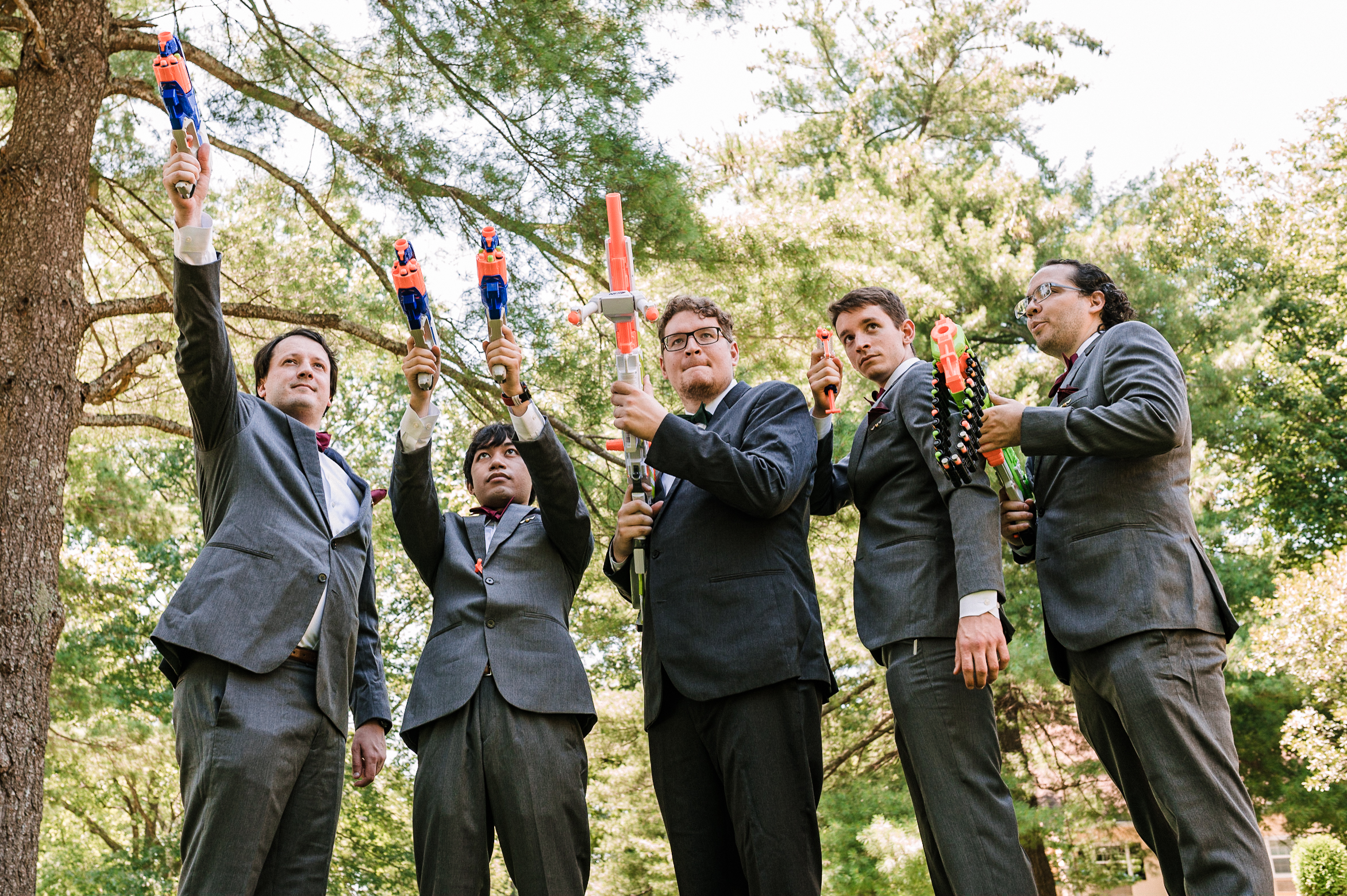 groom and groomsmen holding nerf guns at Airlie