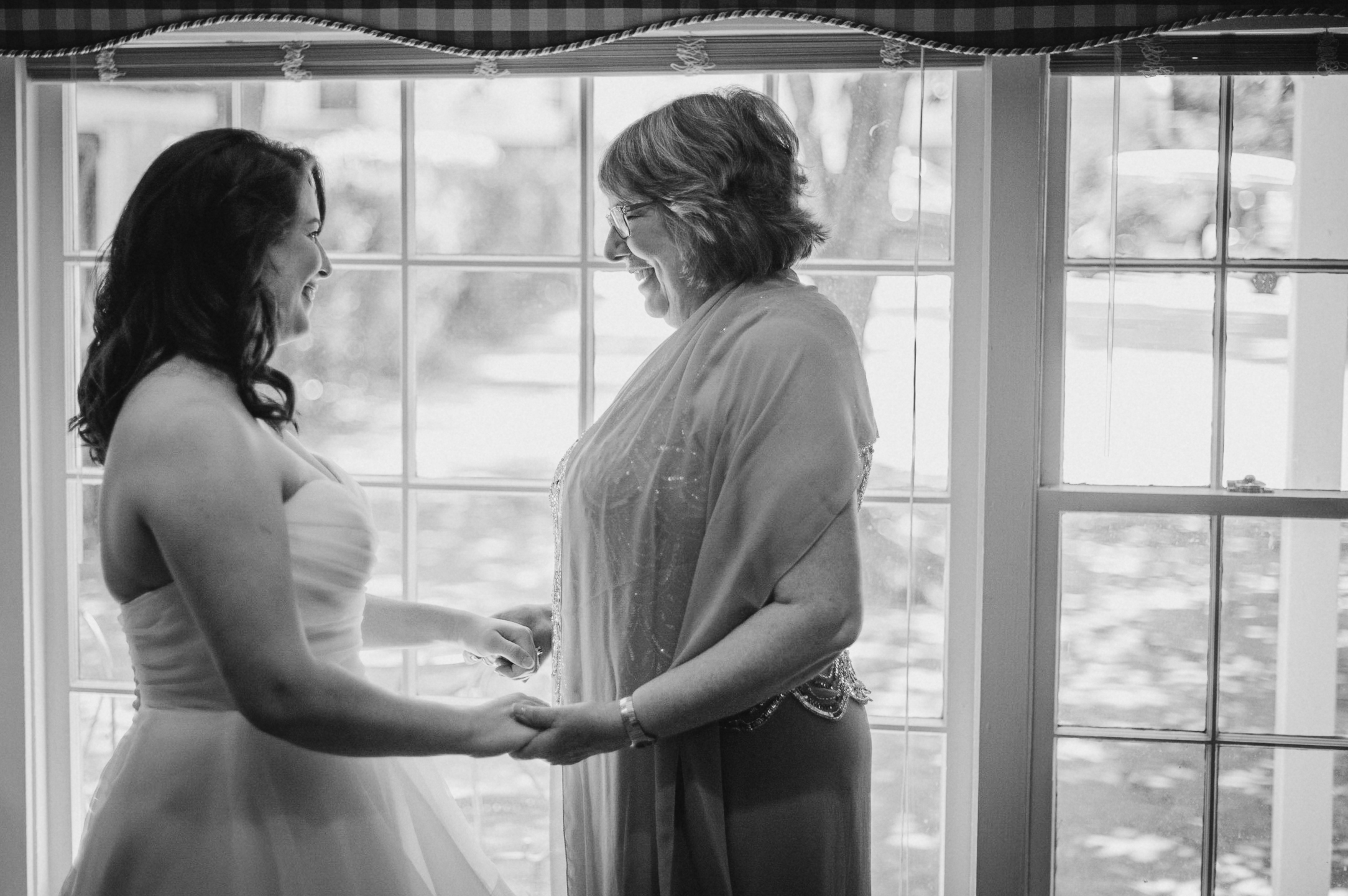 bride and her mother holding hands at Airlie