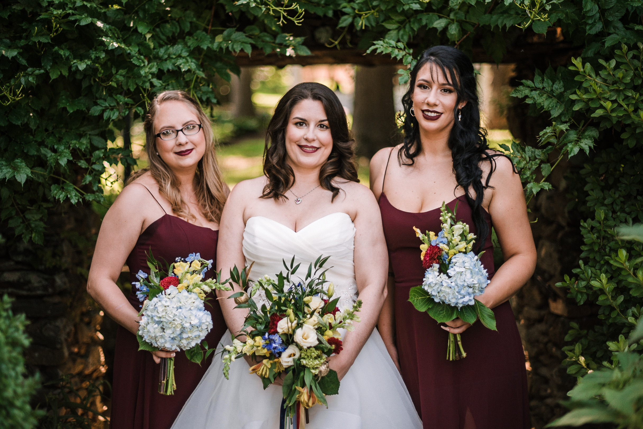 bride and bridesmaids smiling at Airlie
