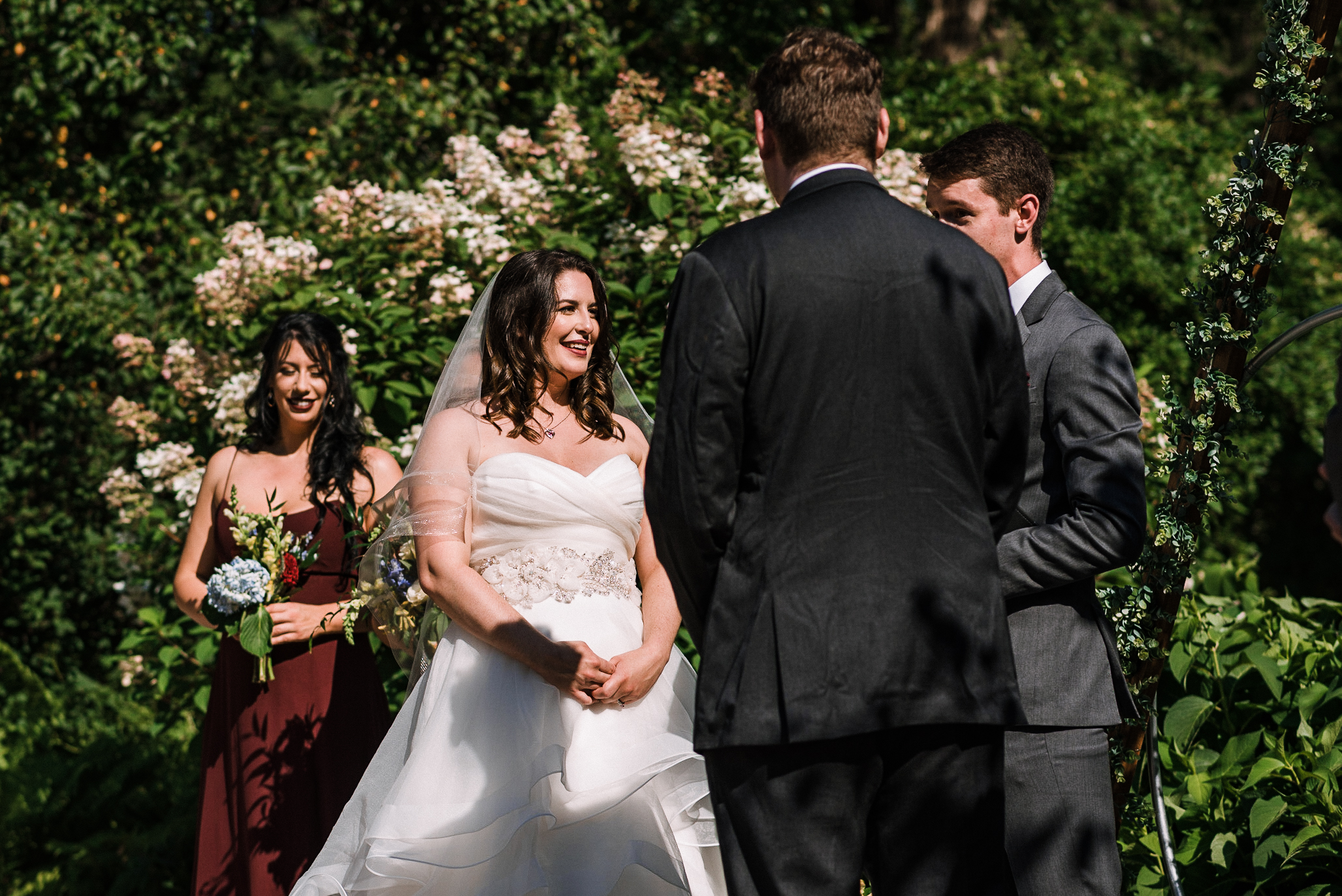 bride smiling at ceremony at Airlie
