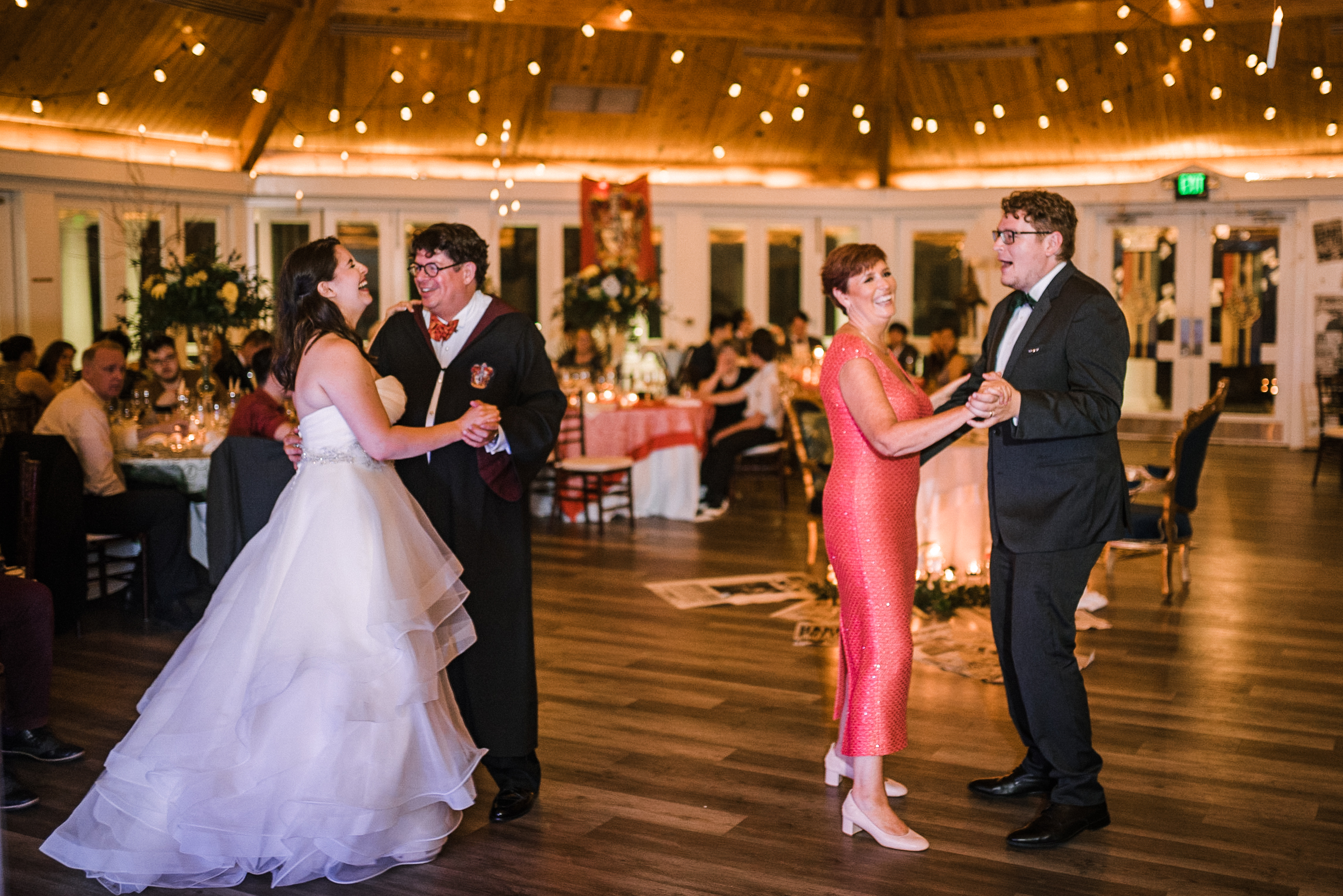 bride and groom dancing with their parents at Airlie