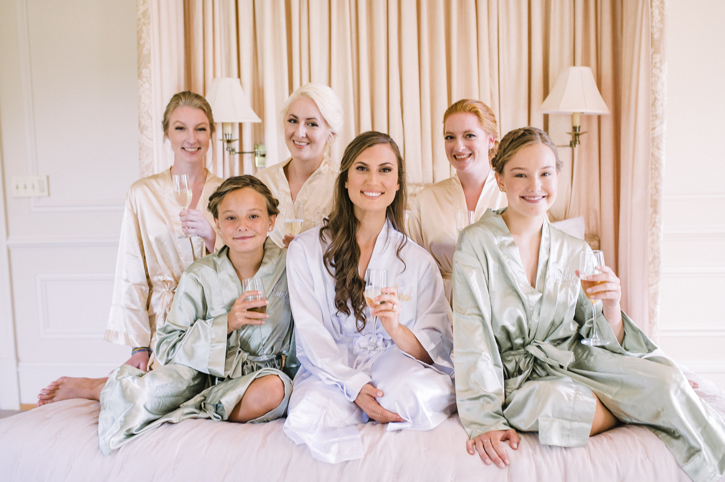 bride and bridesmaids holding champagne glasses at Great Marsh Estate