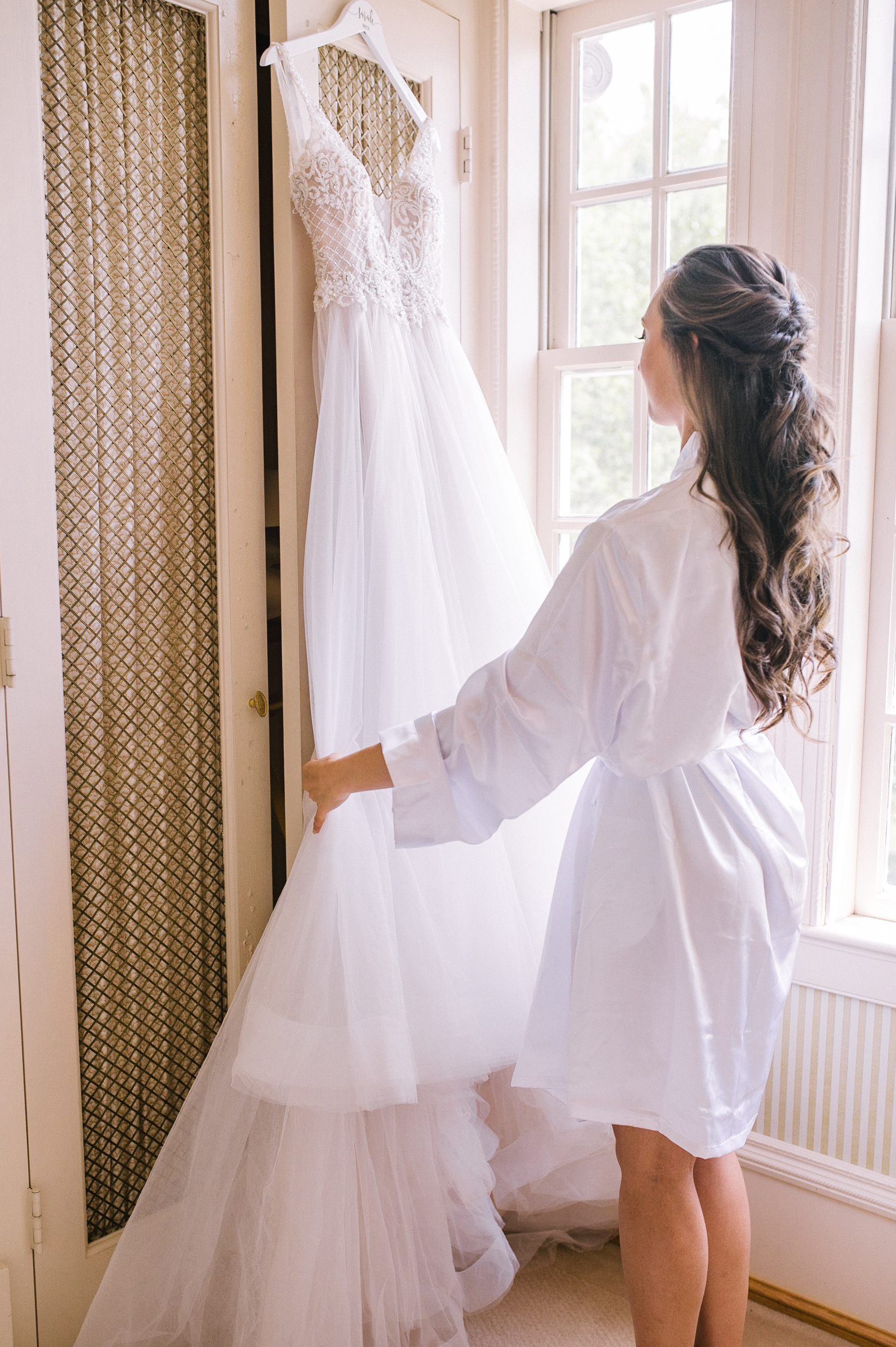 bride admiring wedding dress at Great Marsh Estate