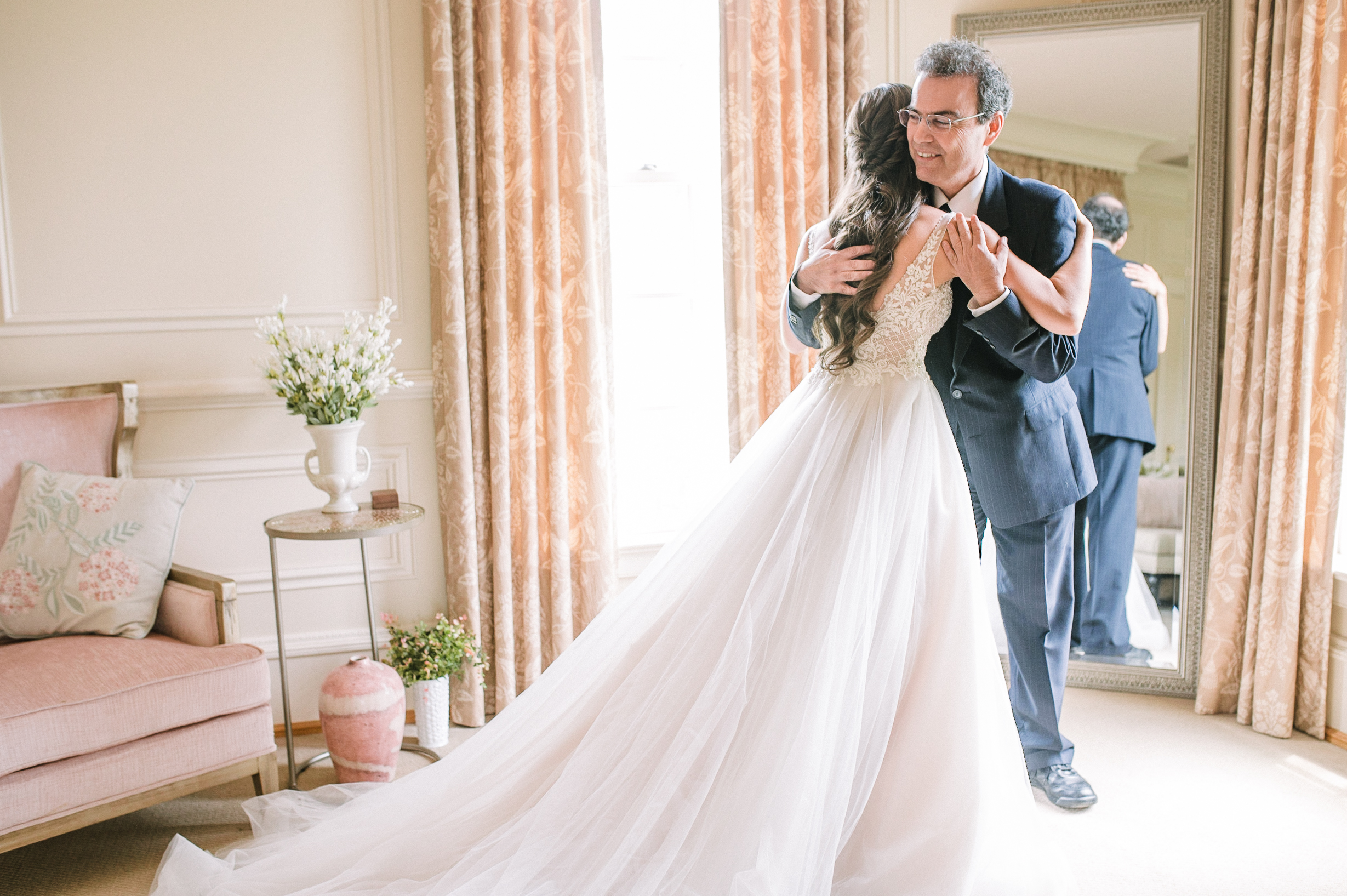 bride does a first look with her father at Great Marsh Estate