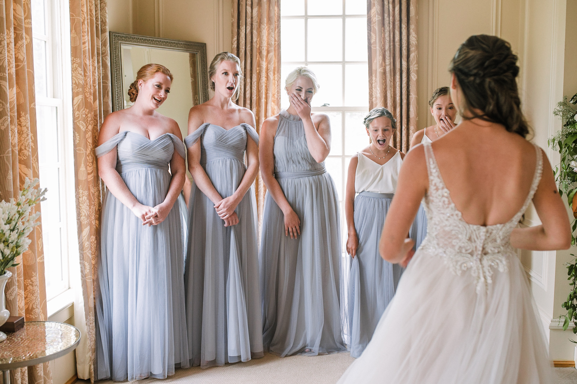 bride does a first look with her bridesmaids at Great Marsh Estate