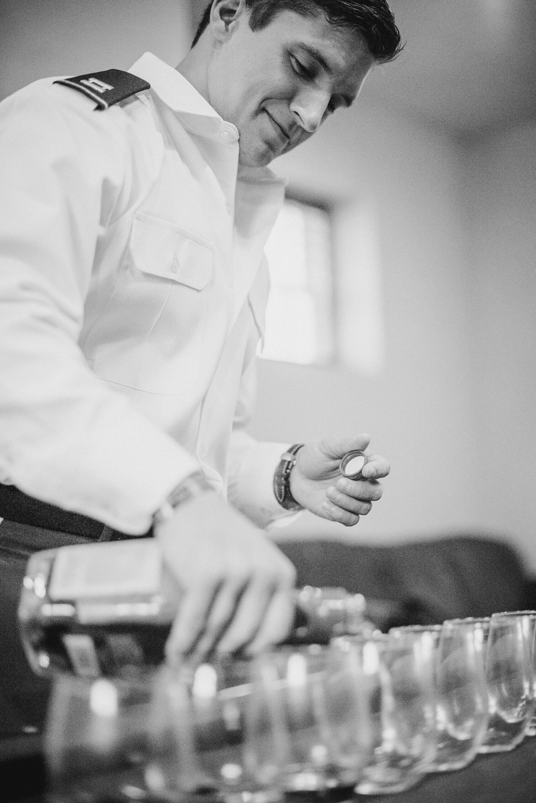 groom pouring drinks at Great Marsh Estate