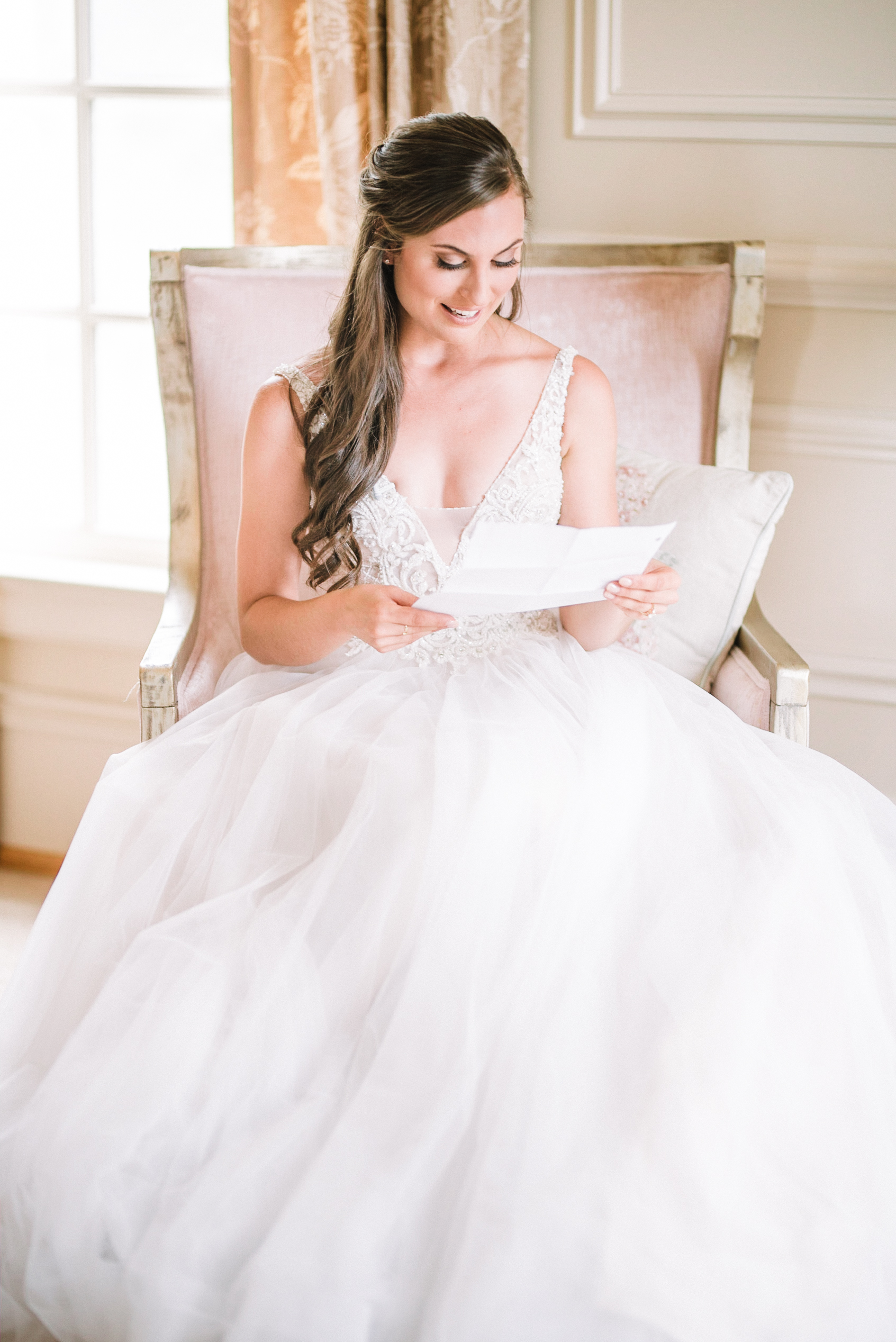 bride reading letter from a groom at Great Marsh Estate