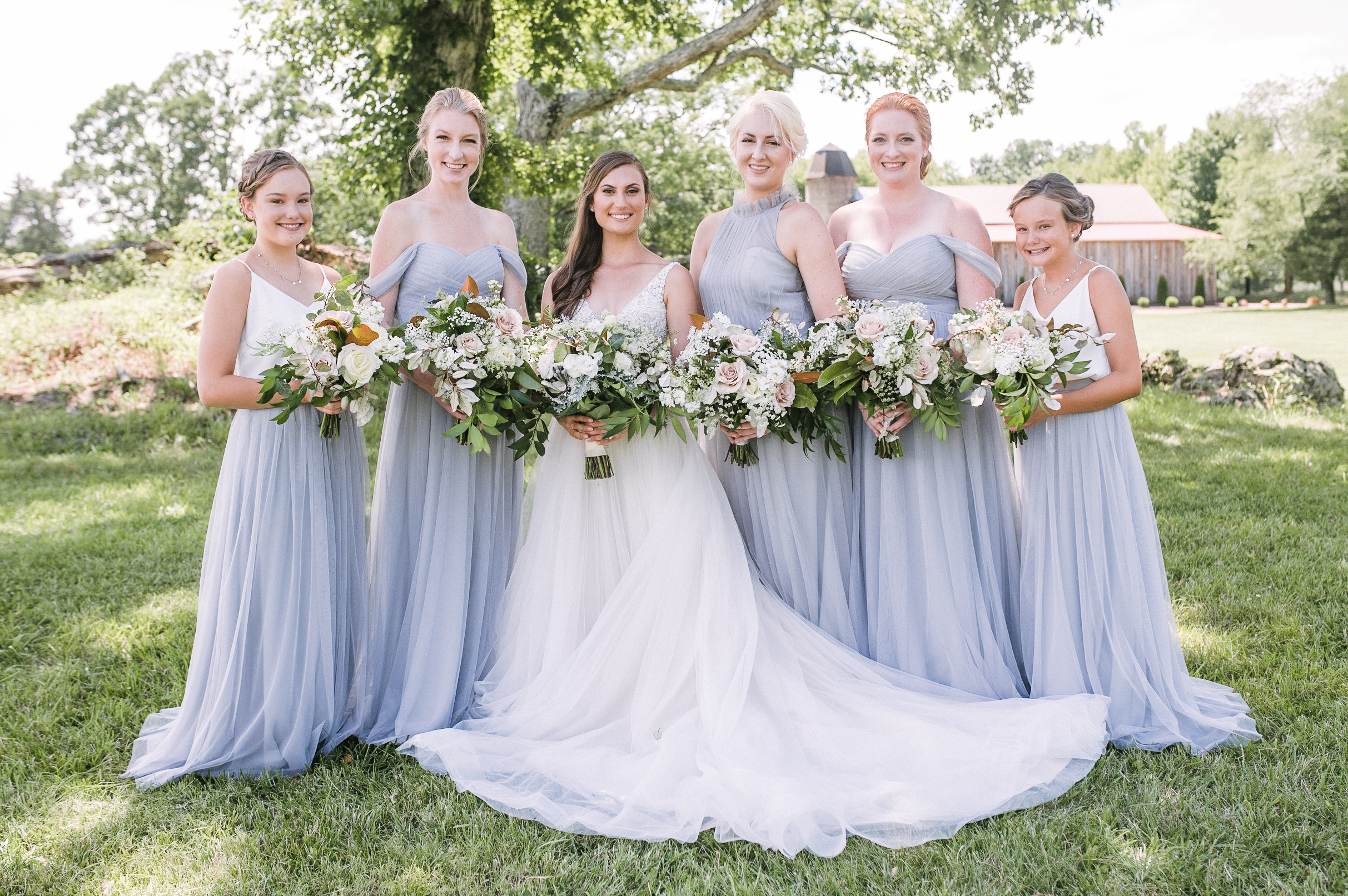 bride and bridesmaids smiling at Great Marsh Estate