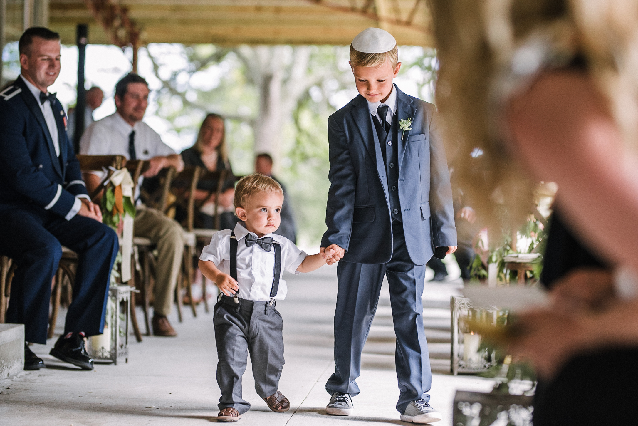 ring bearers coming down the aisle at Great Marsh Estate