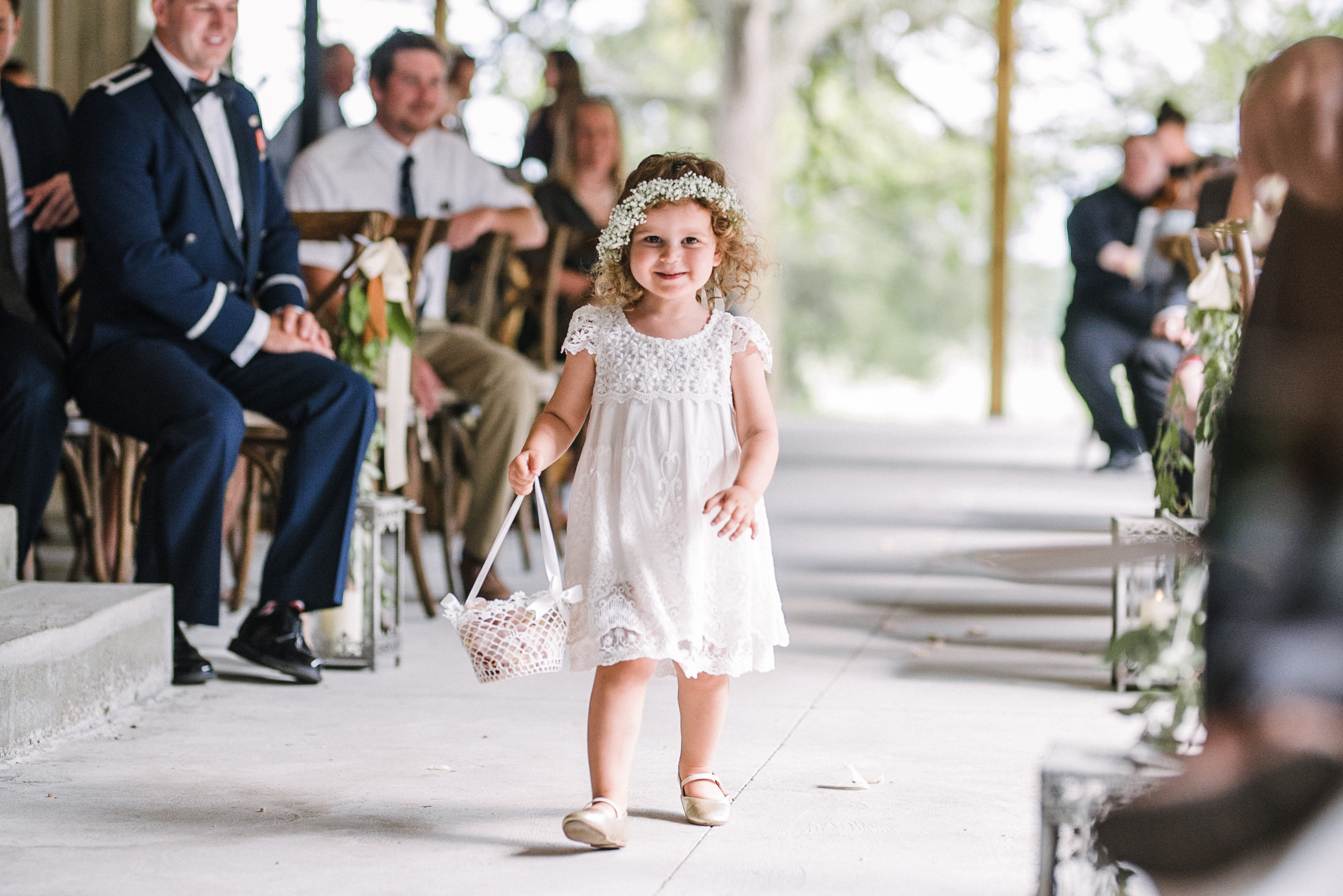 flower girl coming down the aisle at Great Marsh Estate
