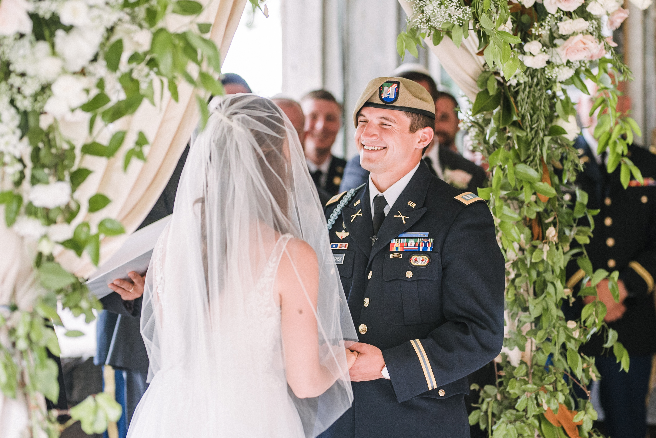 groom smiling during wedding ceremony at Great Marsh Estate