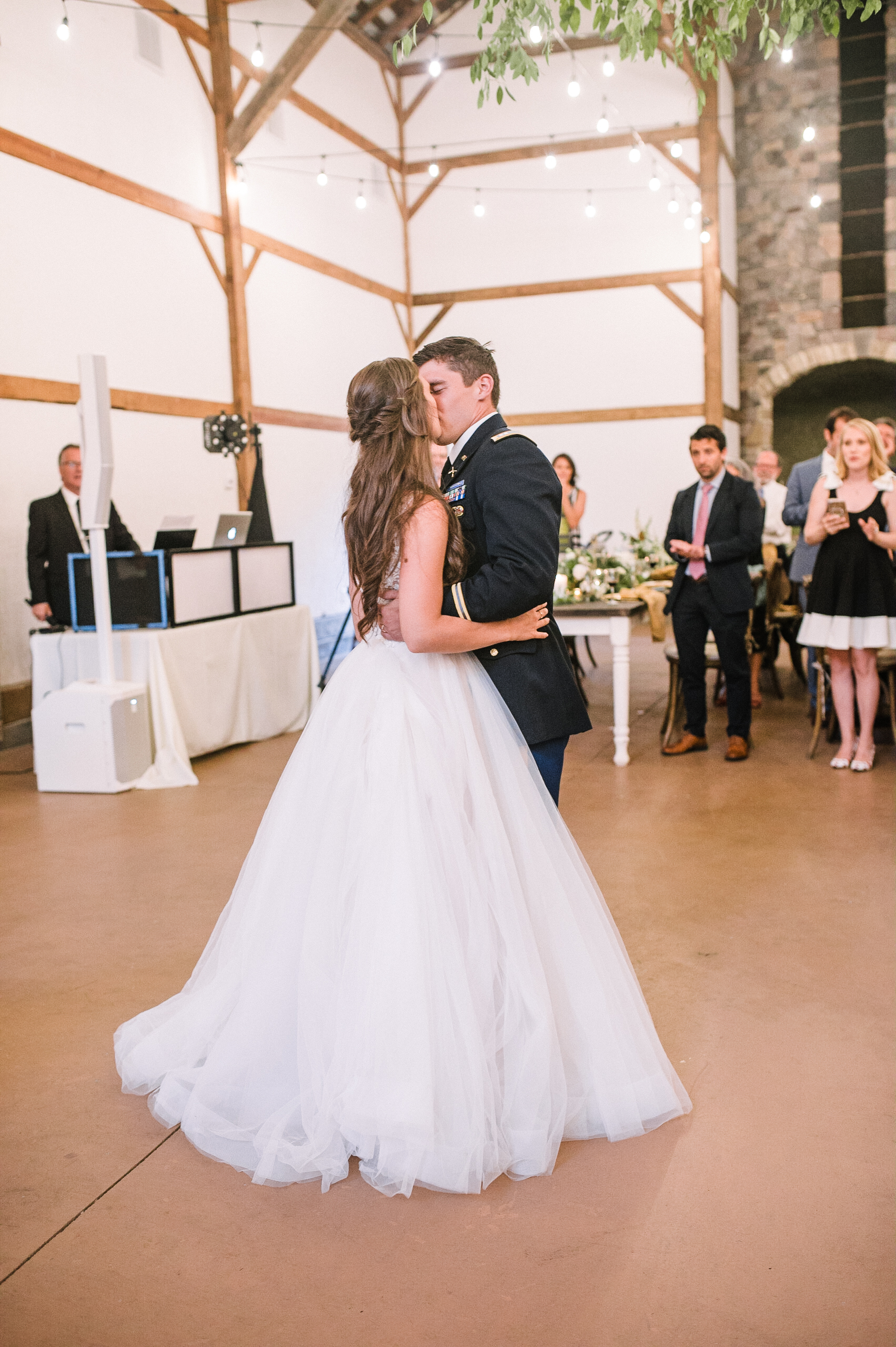 bride and groom kissing during first dance at Great Marsh Estate
