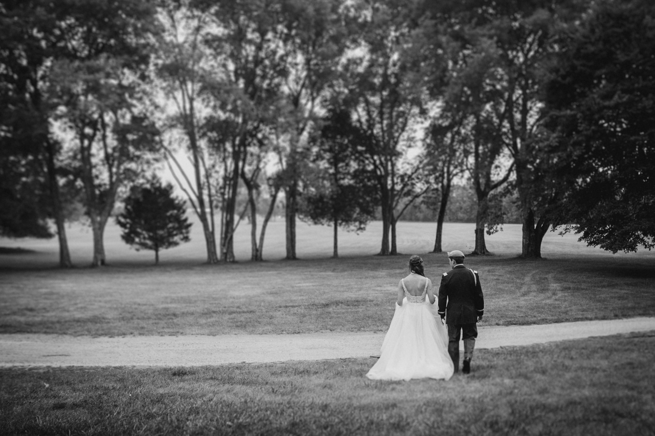 bride and groom walking together at Great Marsh Estate