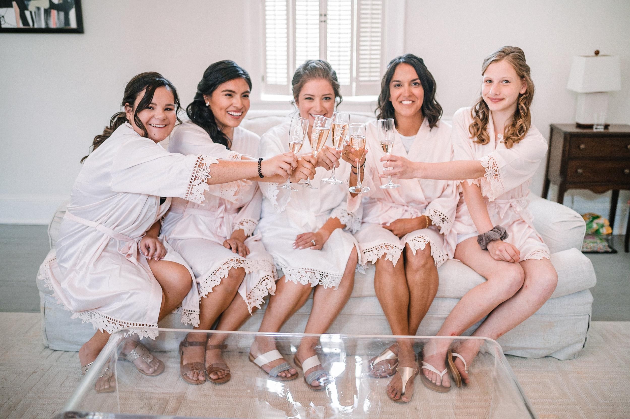 bride and bridesmaids cheering at Birkby House