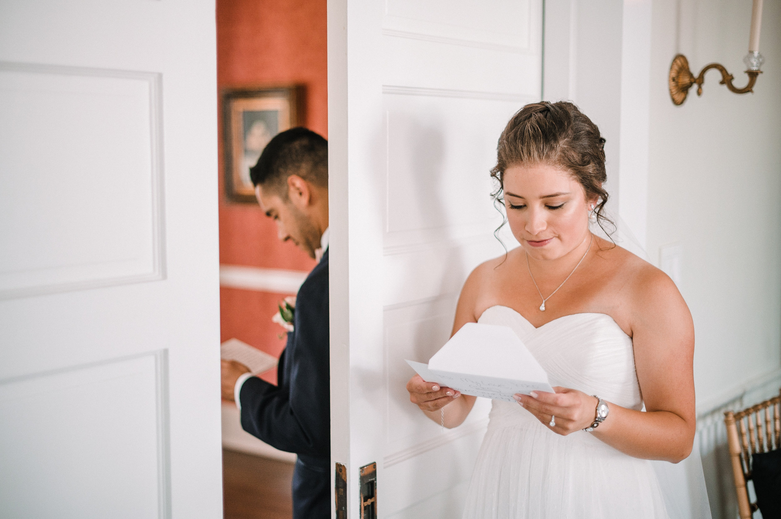 bride and groom reading letters at Birkby House