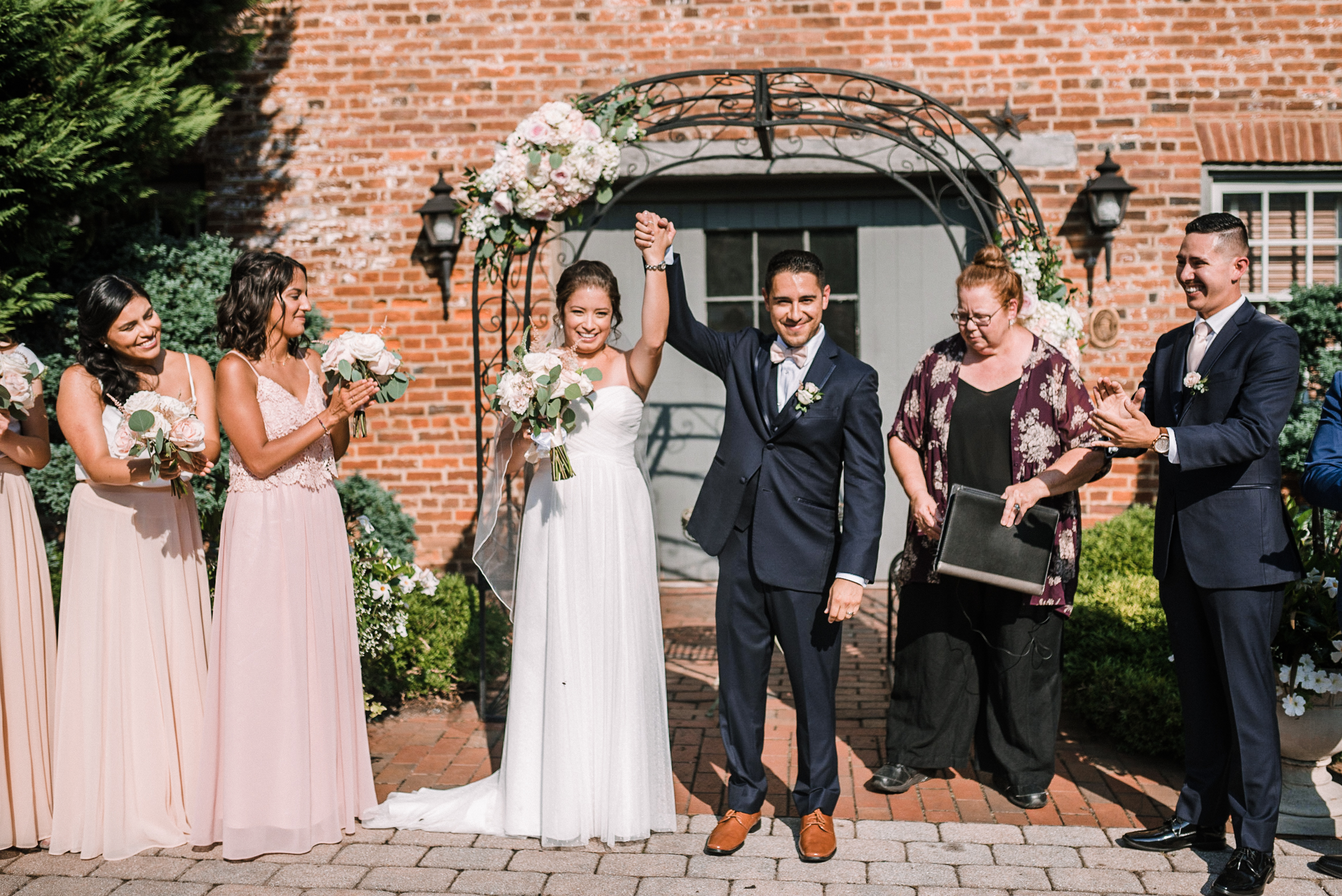 bride and groom smiling after getting married at Birkby House