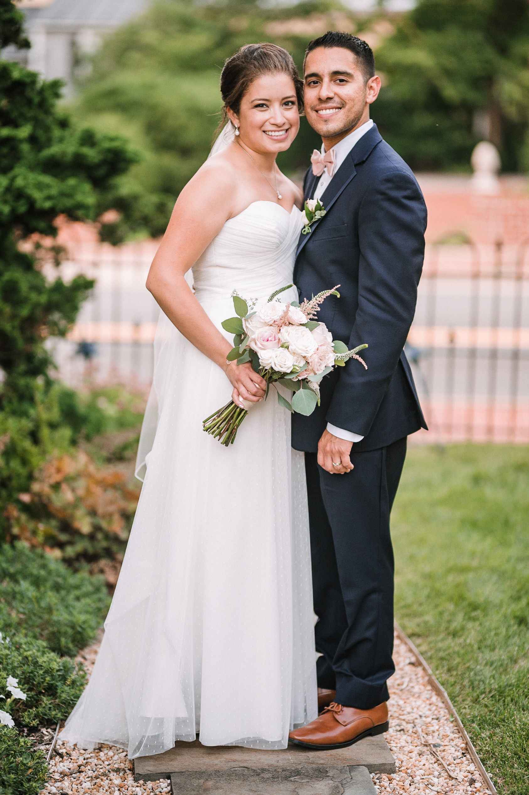 bride and groom smiling at Birkby House