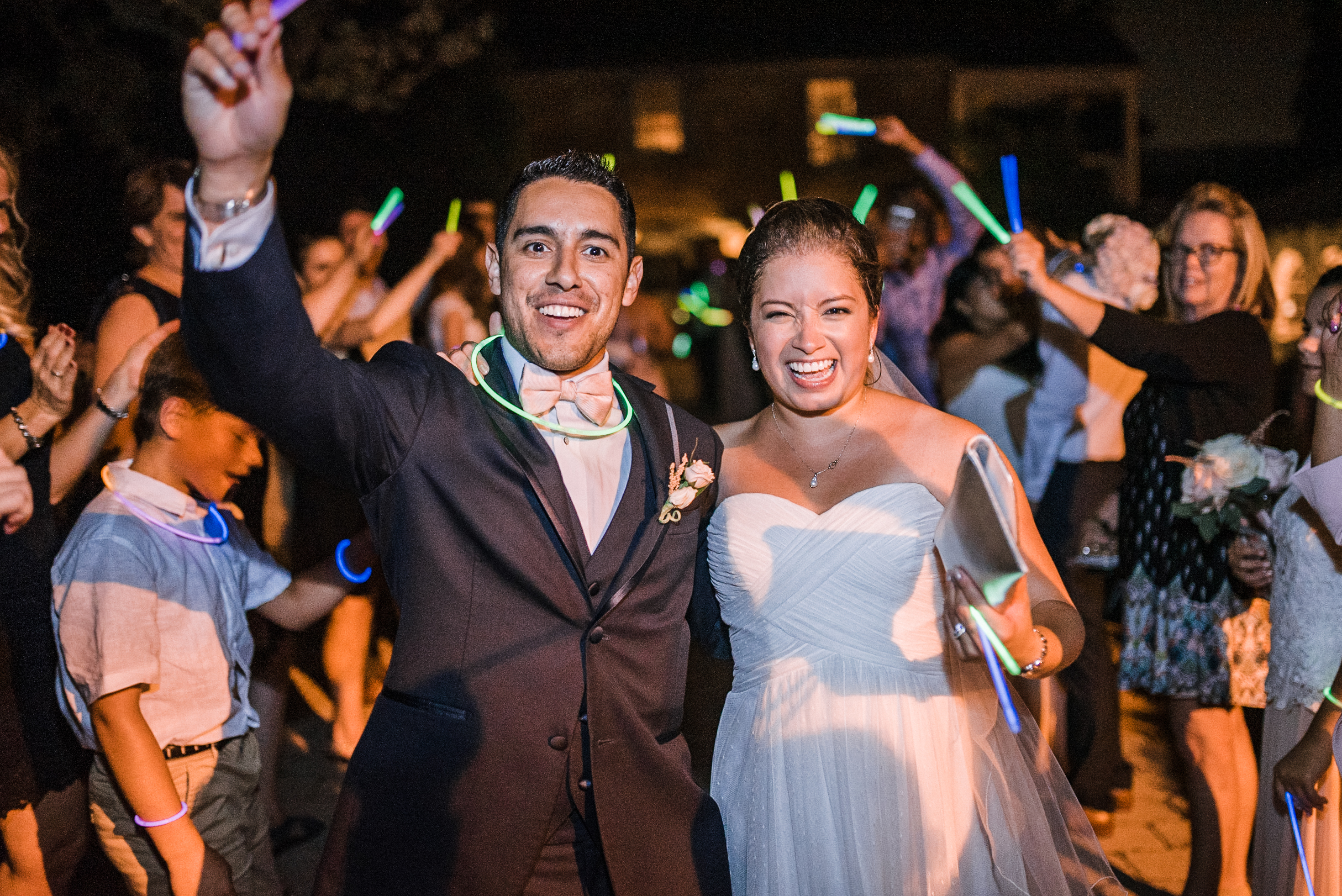 bride and groom glow stick exit at Birkby House