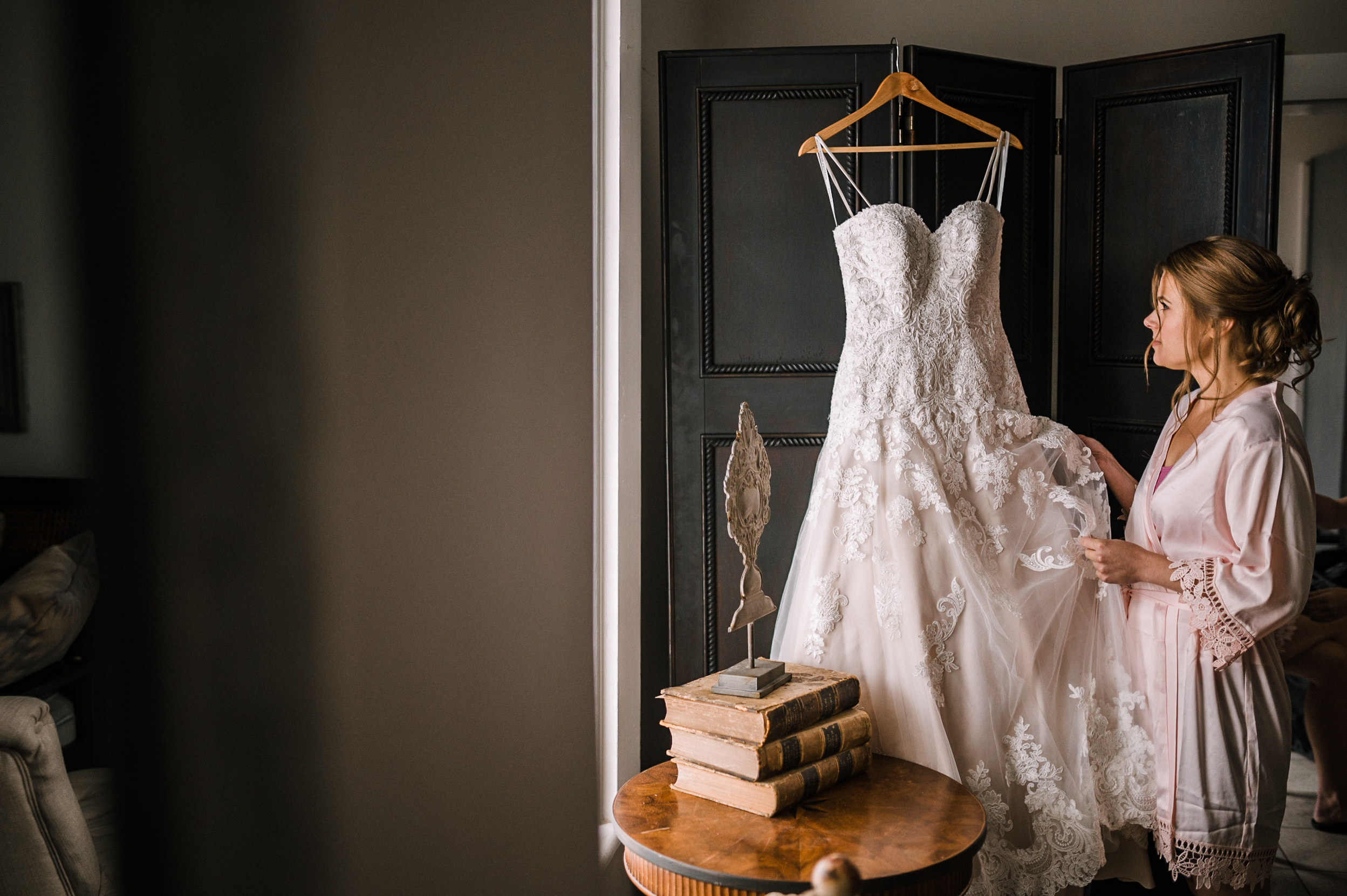 bride admiring wedding dress at Faithbrooke Barn & Vineyards