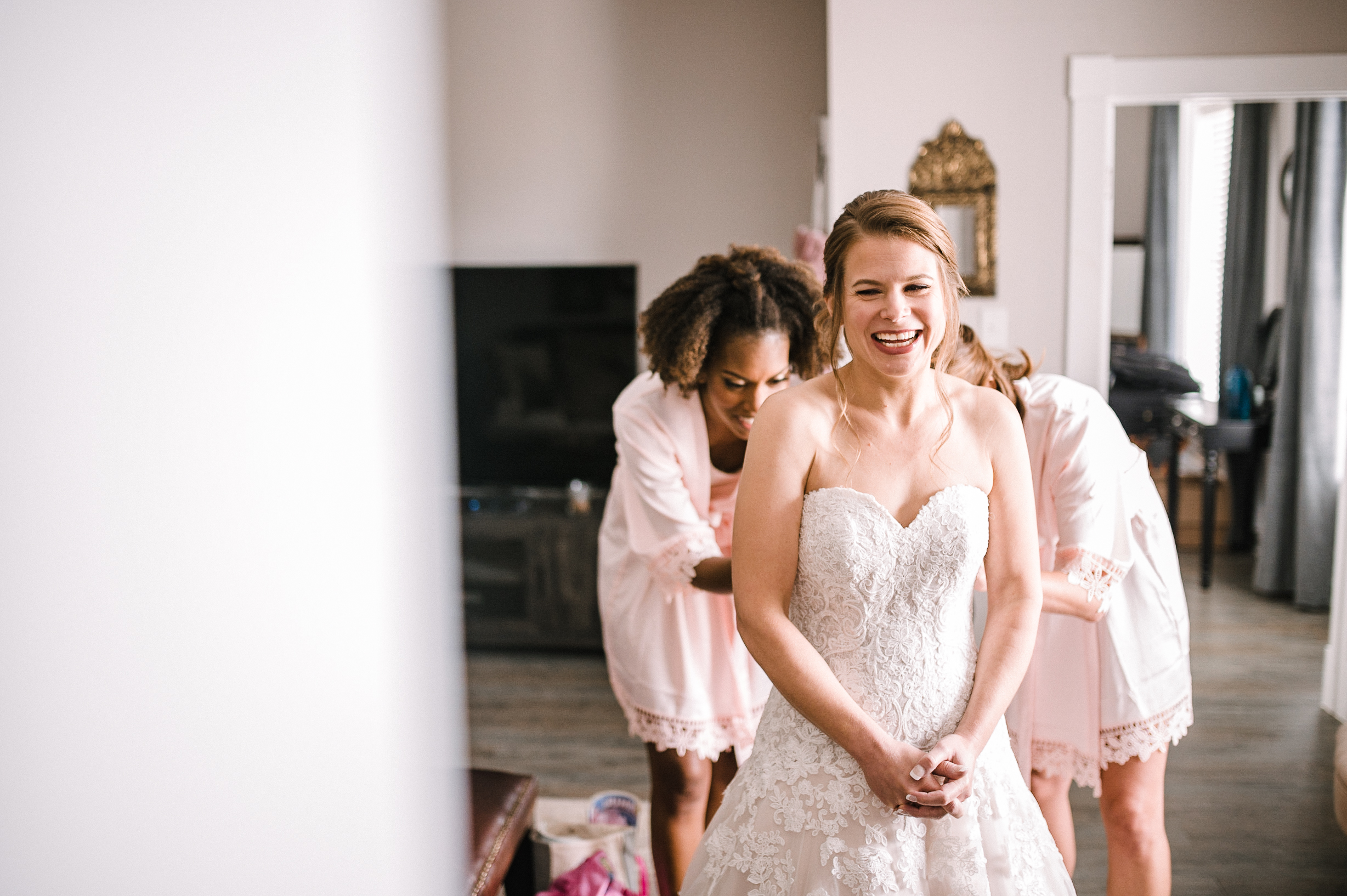 bride smiling as she gets ready at Faithbrooke Barn & Vineyards