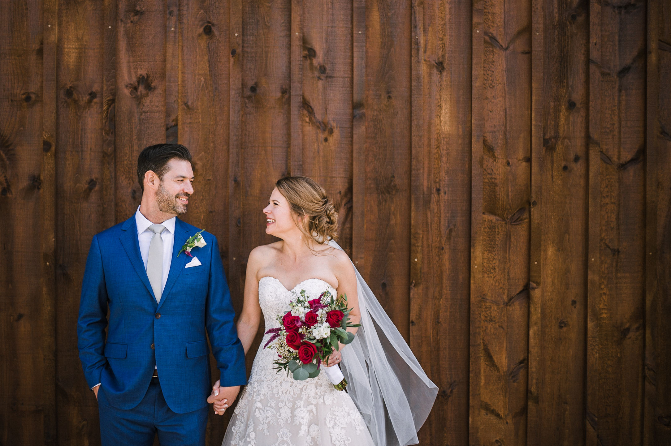 bride and groom holding hands at Faithbrooke Barn & Vineyards