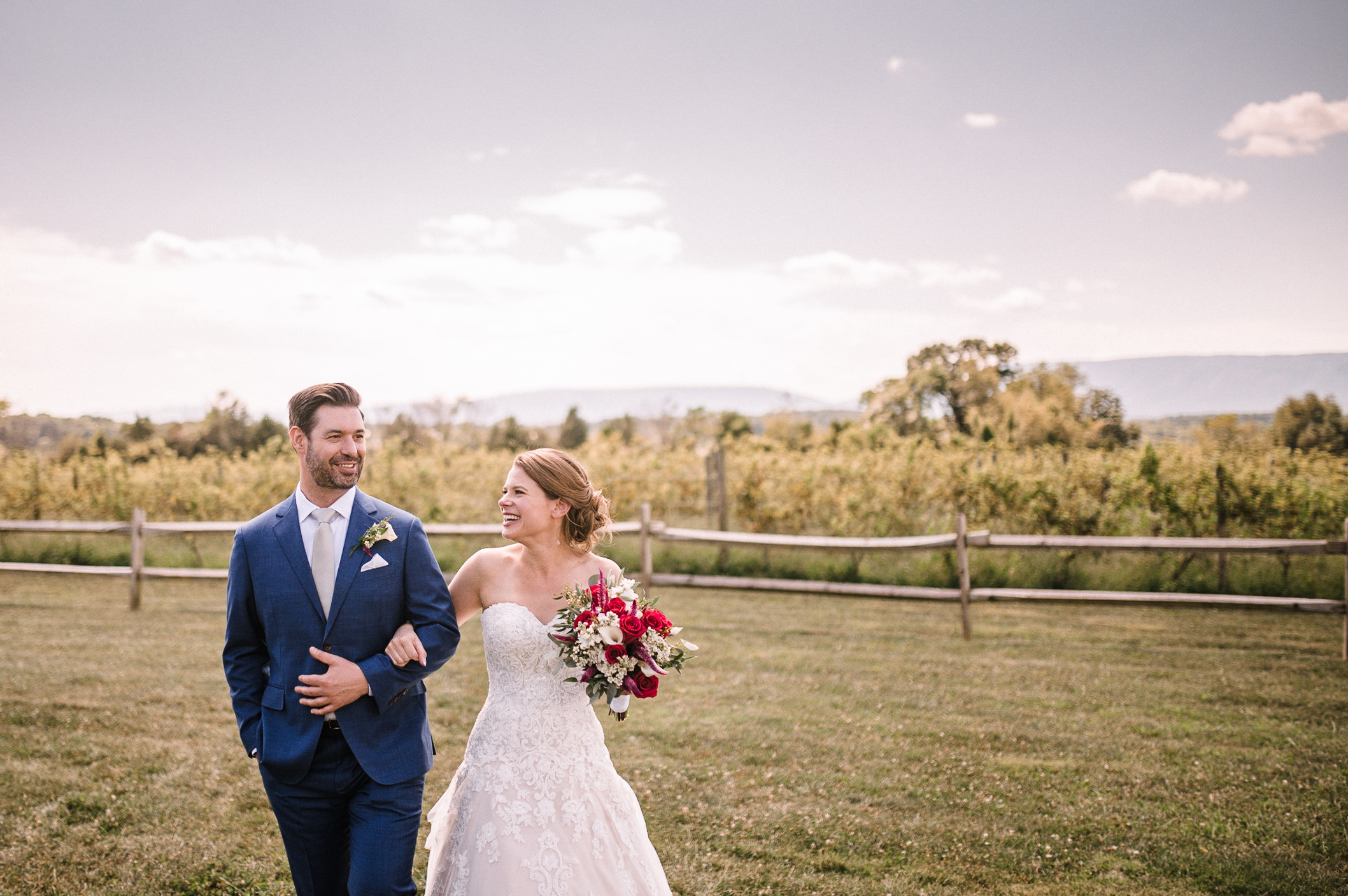 bride and groom smiling as they hold hands at Faithbrooke Barn & Vineyards